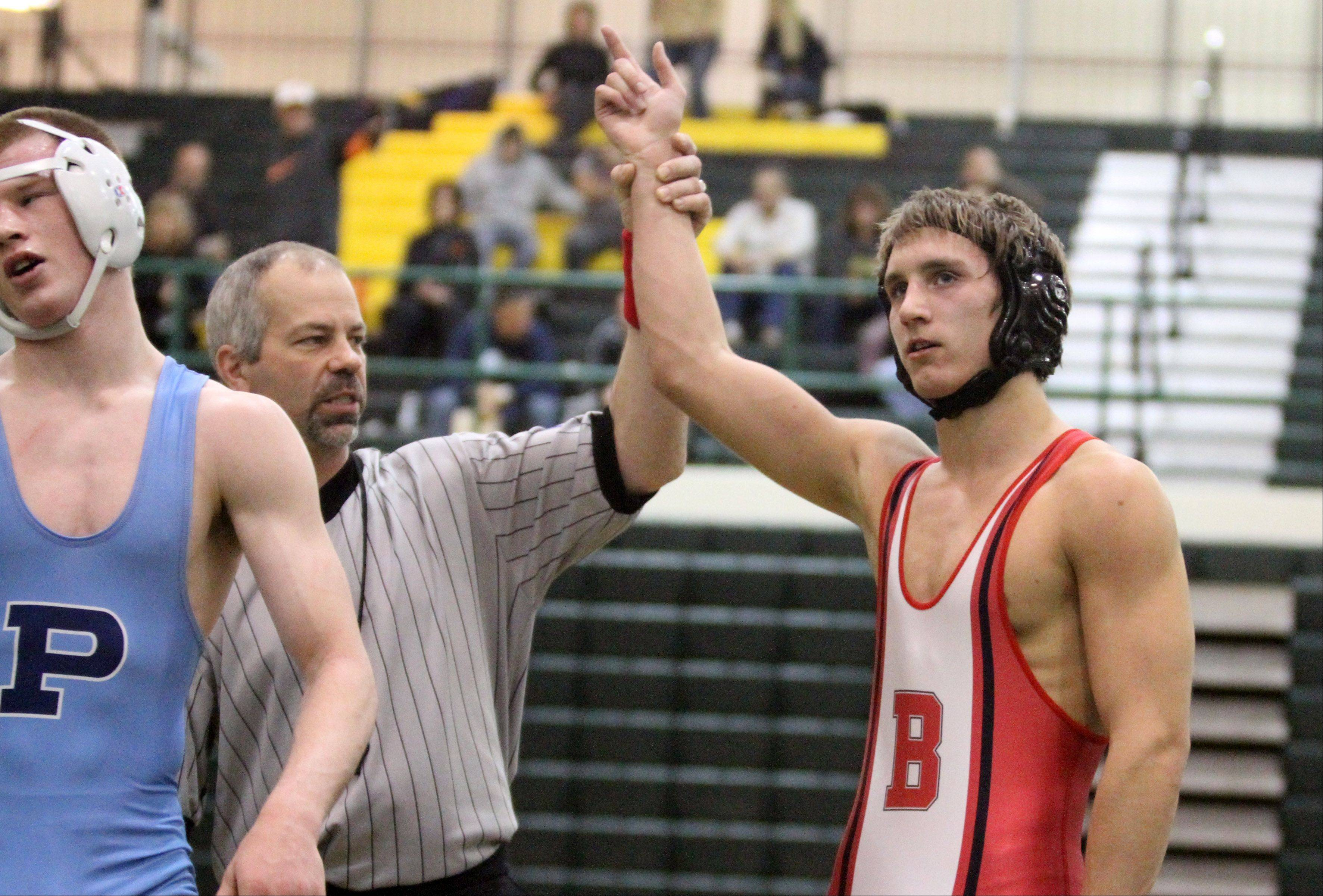 Barrington�s Coord Wiseman wins the 145-pound final match against Prospect�s Brian Maigler at the Mid-Suburban League championships at Fremd on Saturday.
