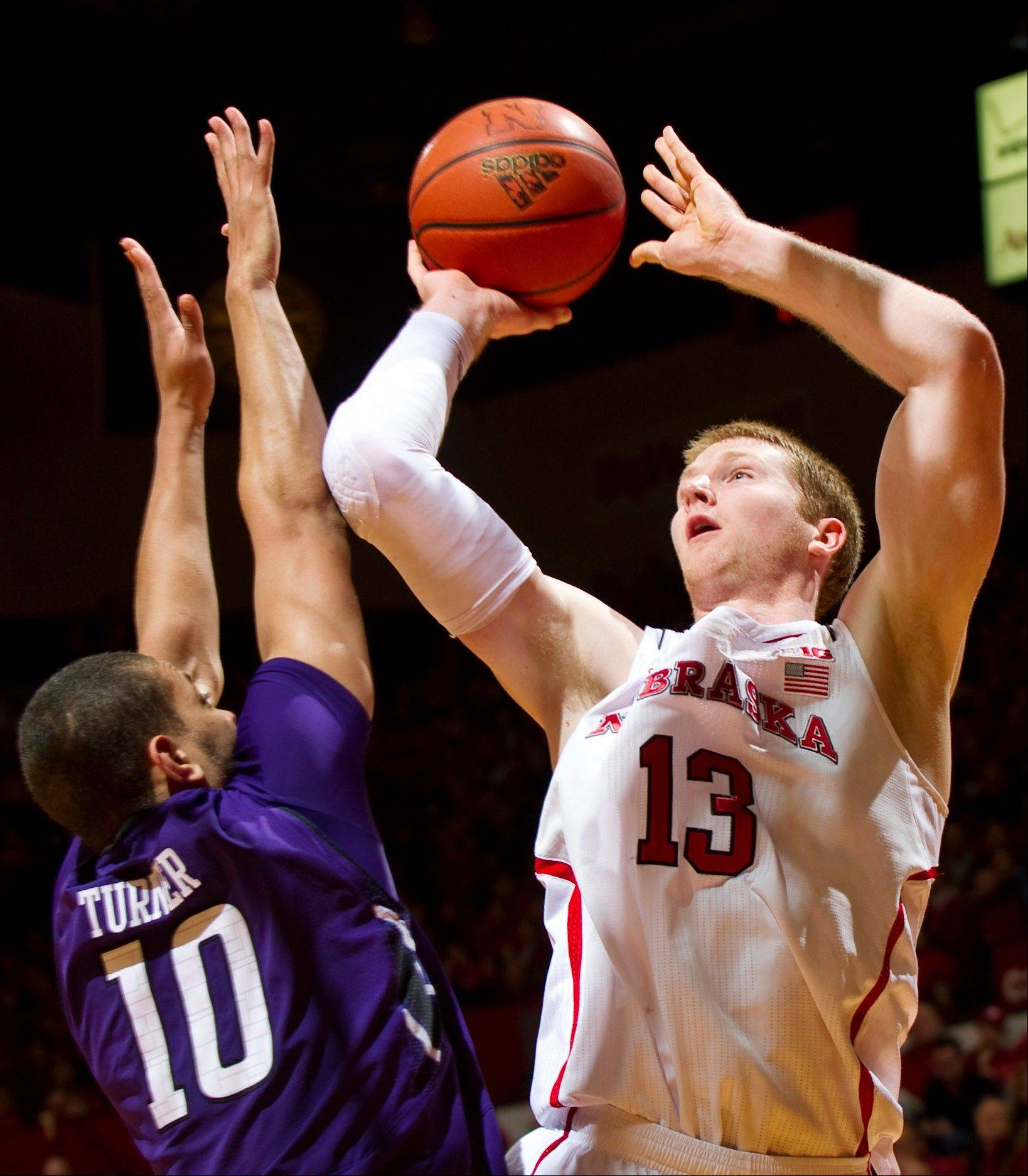 Nebraska's Brandon Ubel (13) shoots over Northwestern's Mike Turner (10) during the first half of their NCAA college basketball game, Saturday, Jan. 26, 2013, in Lincoln, Neb. (AP Photo/The Journal-Star, Matt Ryerson) LOCAL TV OUT; KOLN-TV OUT; KGIN-TV OUT; KLKN-TV OUT