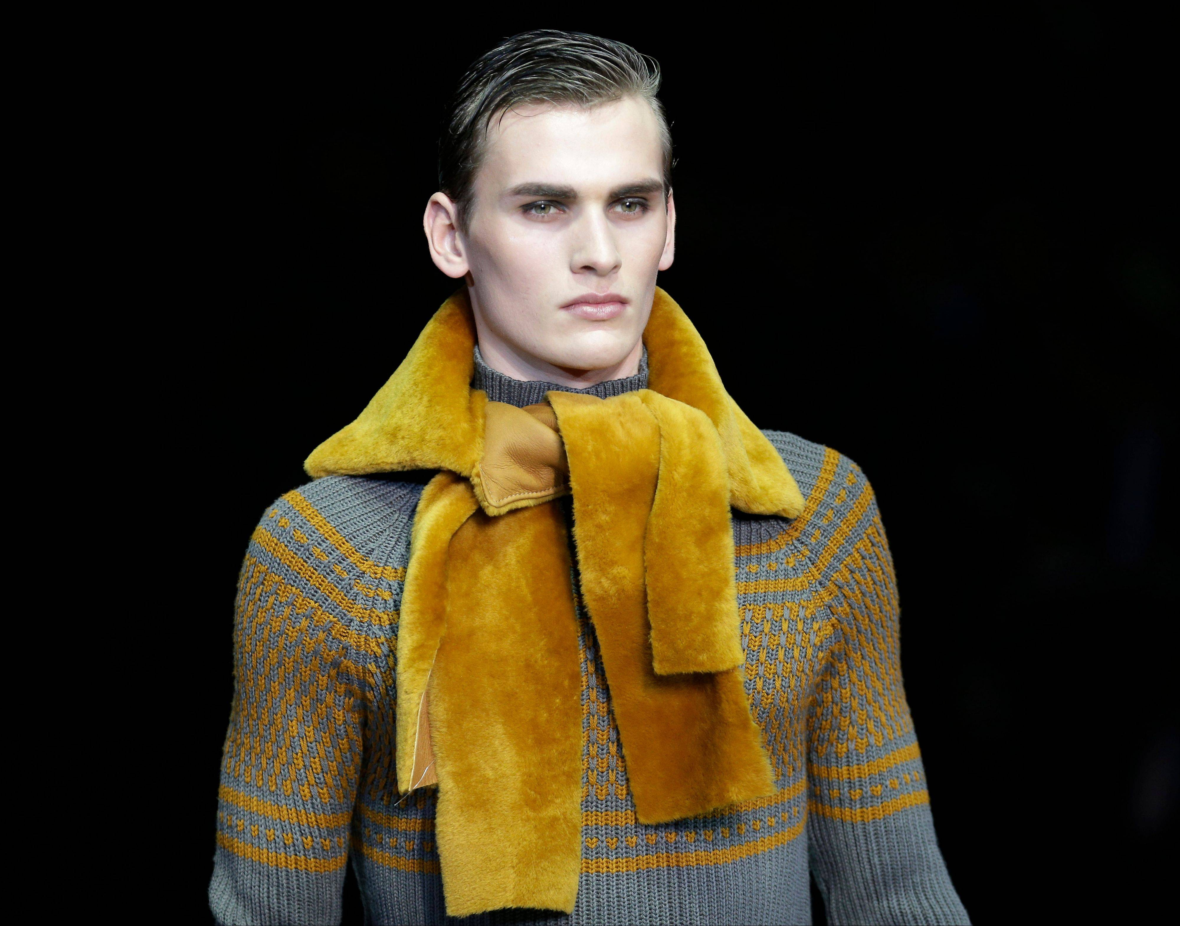 A model wears a creation for Emporio Armani men's Fall-Winter 2013-14 collection unveiled in Milan, Italy.
