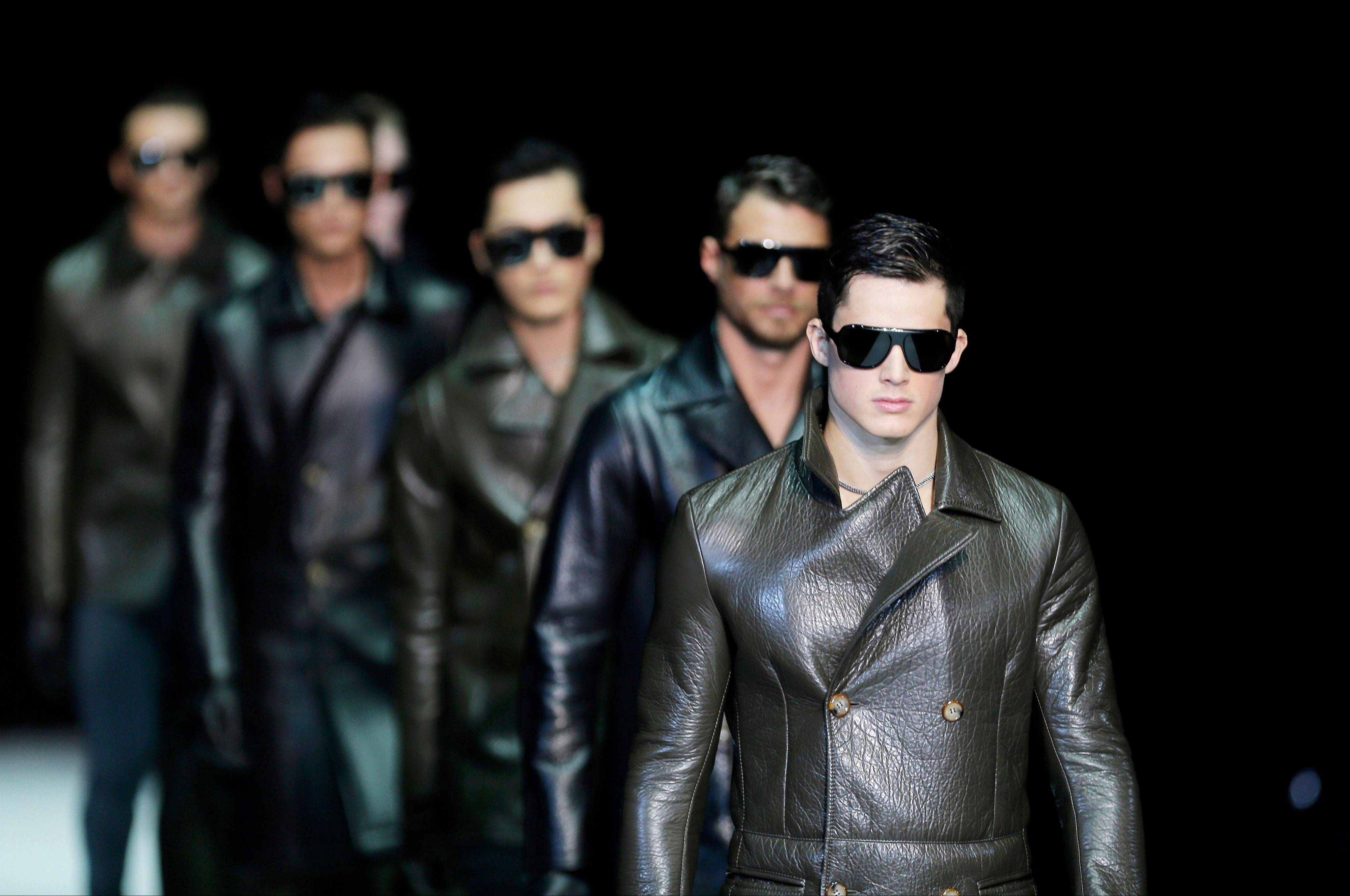 Models wear creations for Emporio Armani men's Fall-Winter 2013-14 collection.
