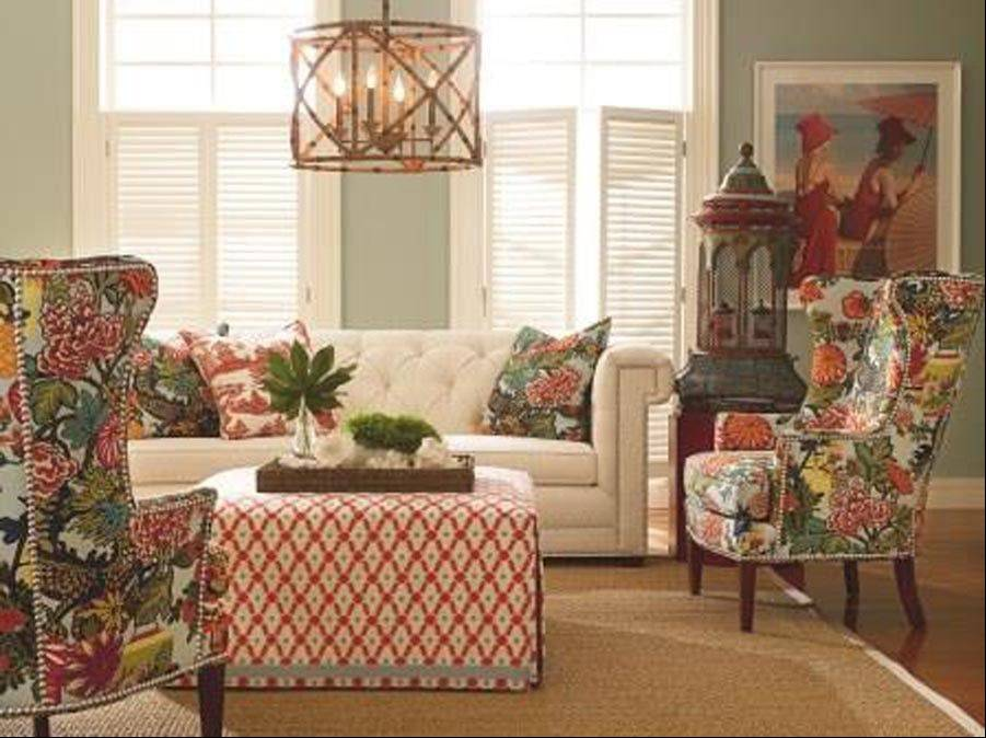 Start with a creamy tufted sofa featuring nailhead trim. Add a pair of tall winged-back chairs covered in rich tones. Finish off with accessories that rev up or soften your color statement, as you see fit.