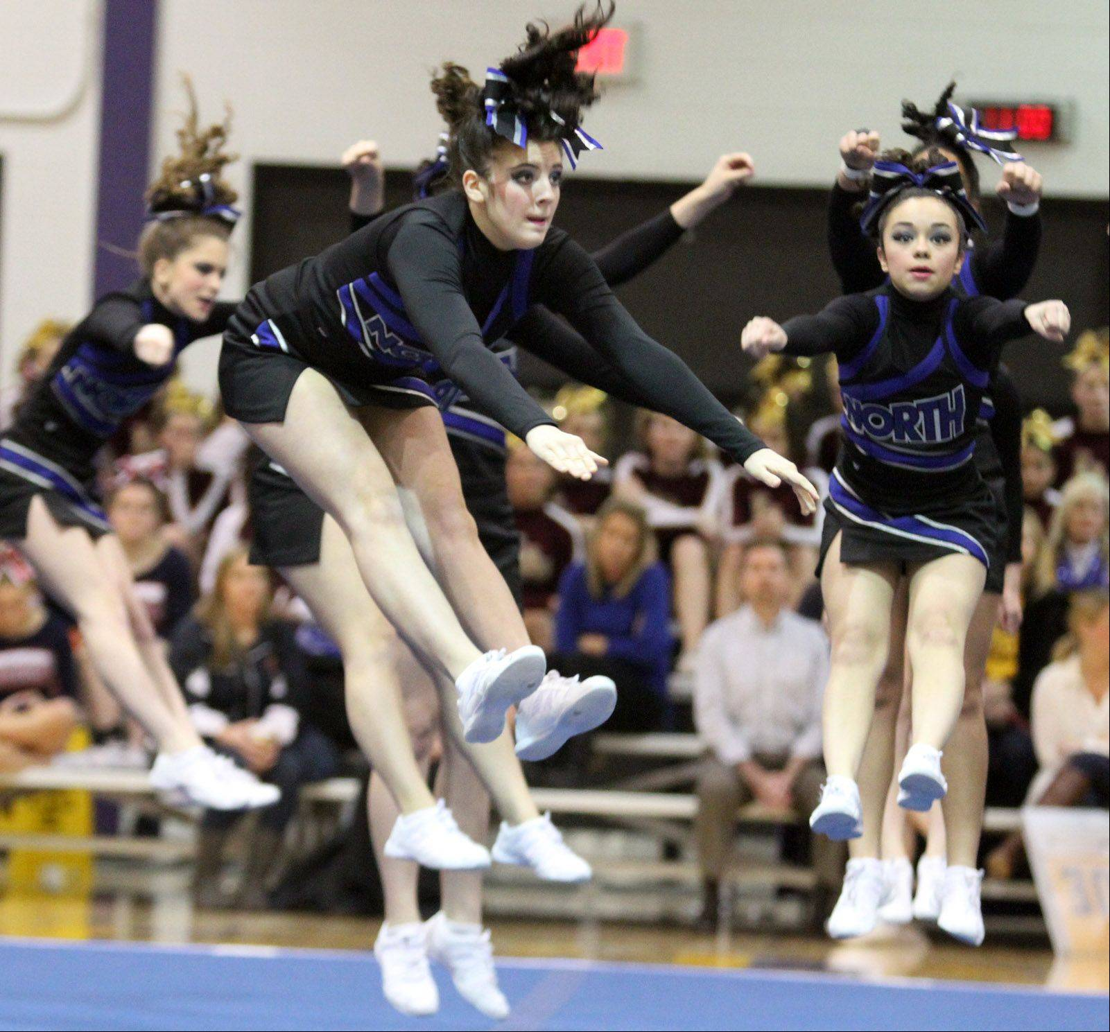 The St. Charles North High School cheer team performs at the IHSA competitive cheerleading sectionals in Rolling Meadows on Saturday.