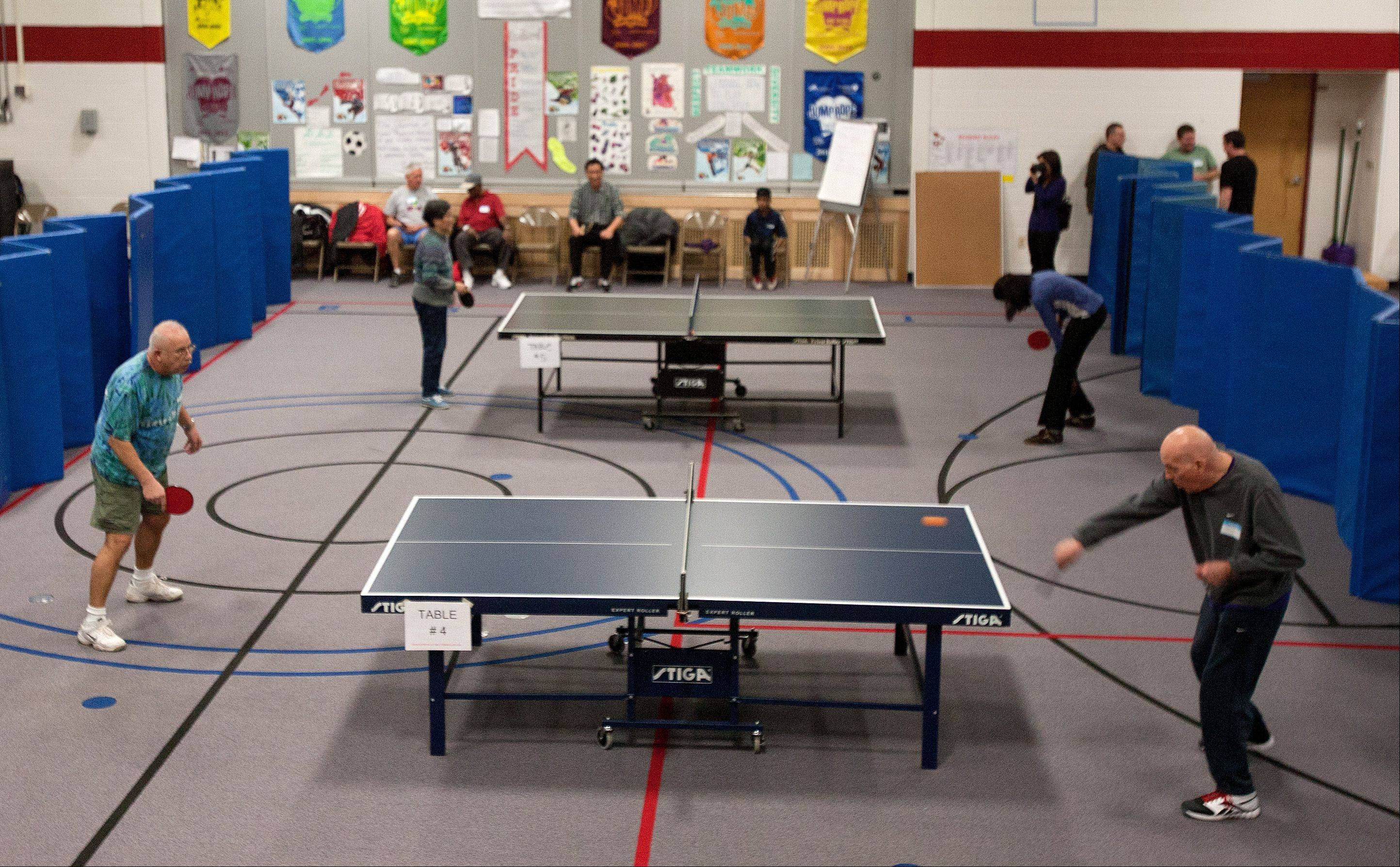 Anatoly Fuksman of Burbank volleys with Carl Bruebach of Plainfield on Saturday as the Naperville Park District and the Naperville Table Tennis Club host the city's annual table tennis championships at River Woods school.