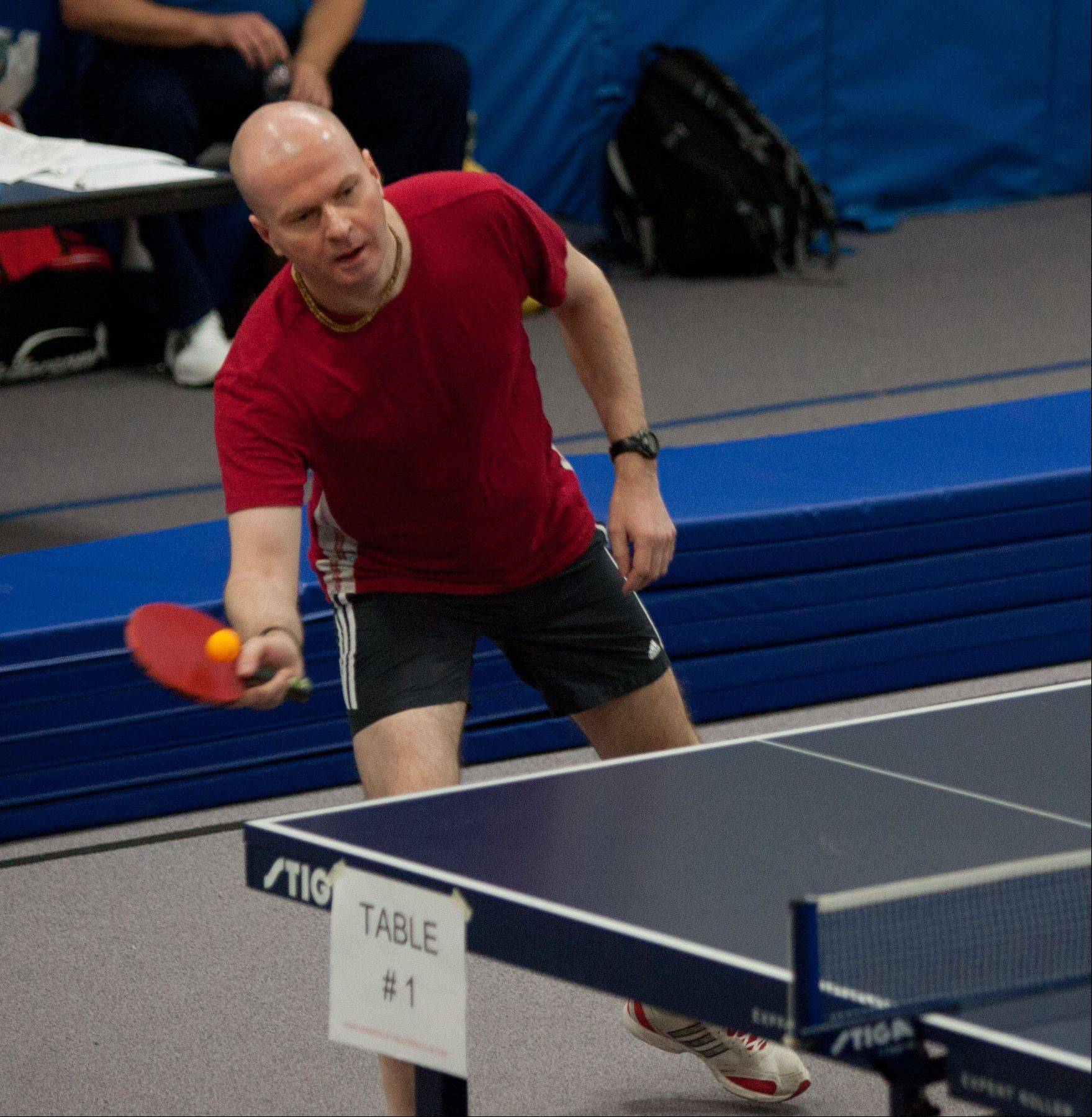 Jacek Wisniewski of Naperville returns a volley Saturday during the annual table tennis championships held by the Naperville Park District and the Naperville Table Tennis Club.