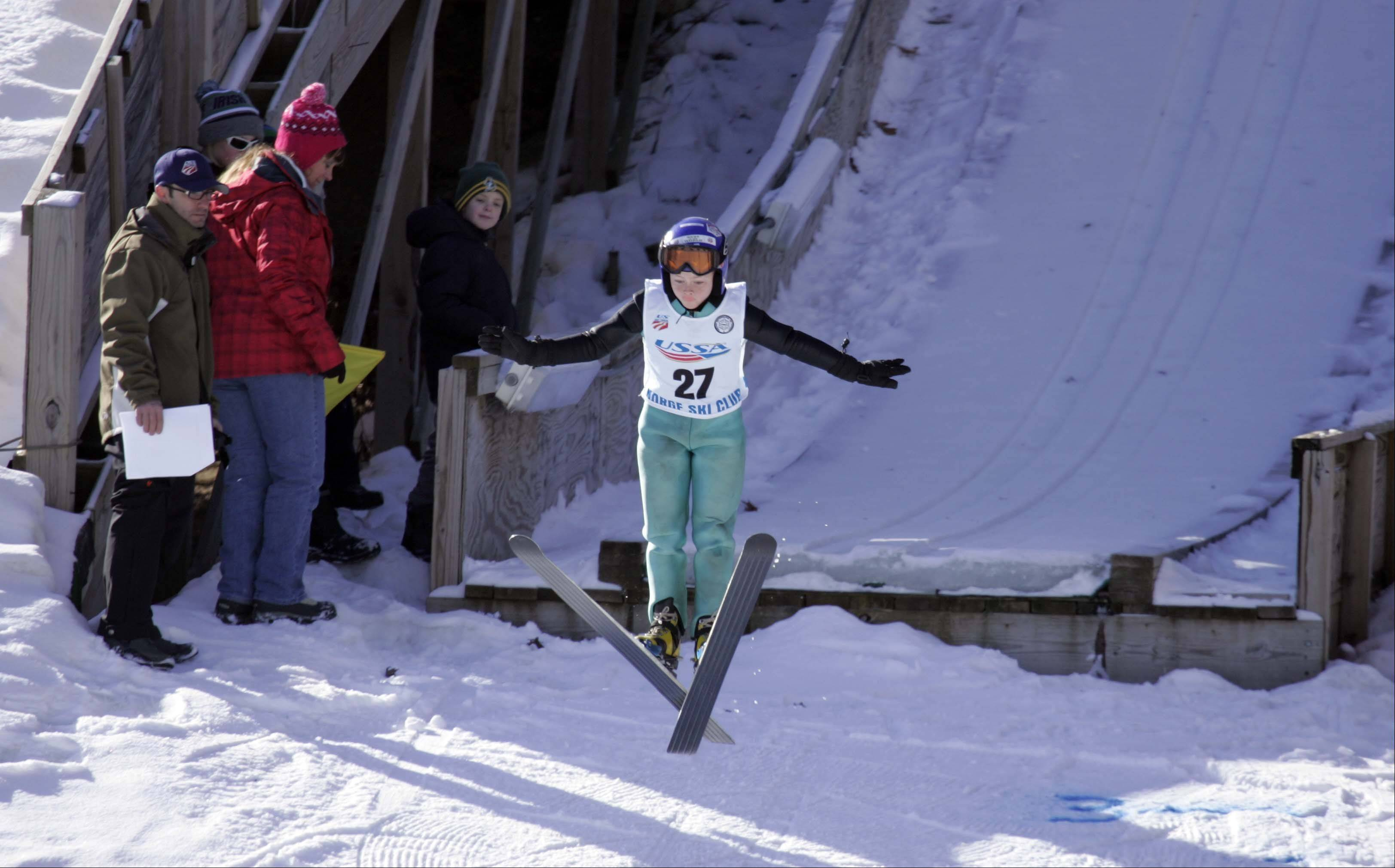 Matthew Smith of the Norge Ski club launches himself off the ramp during the 108th annual Norge International Ski Jumping Tournament Saturday at the Norge Ski Club in Fox River Grove. The junior competition and junior national championship qualifier K70 was Saturday. The K70 U.S. Cup Five Hills Tournament and the Long-Standing Competition are today.