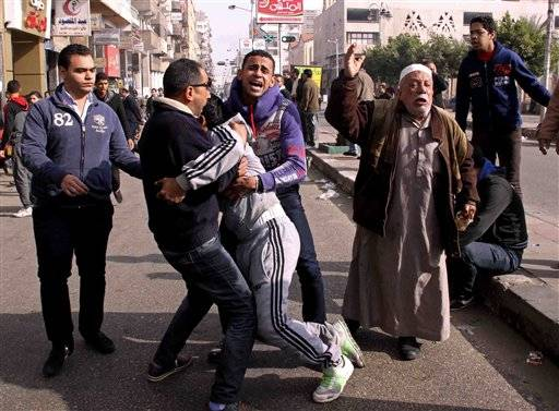 Angry relatives and residents rampaged through an Egyptian port city Saturday in rioting that killed at least 27 people after a judge sentenced nearly two dozen soccer fans to death for involvement in deadly violence after a game last year.