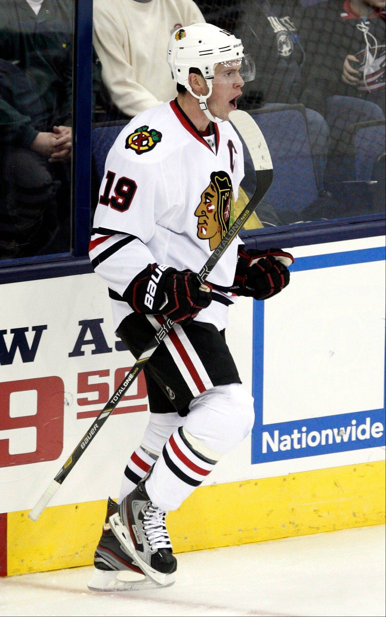 Jonathan Toews celebrates his goal against Columbus Blue Jackets in the third period of an NHL hockey game in Columbus, Ohio, Saturday, Jan. 26, 2013. Chicago won 3-2.