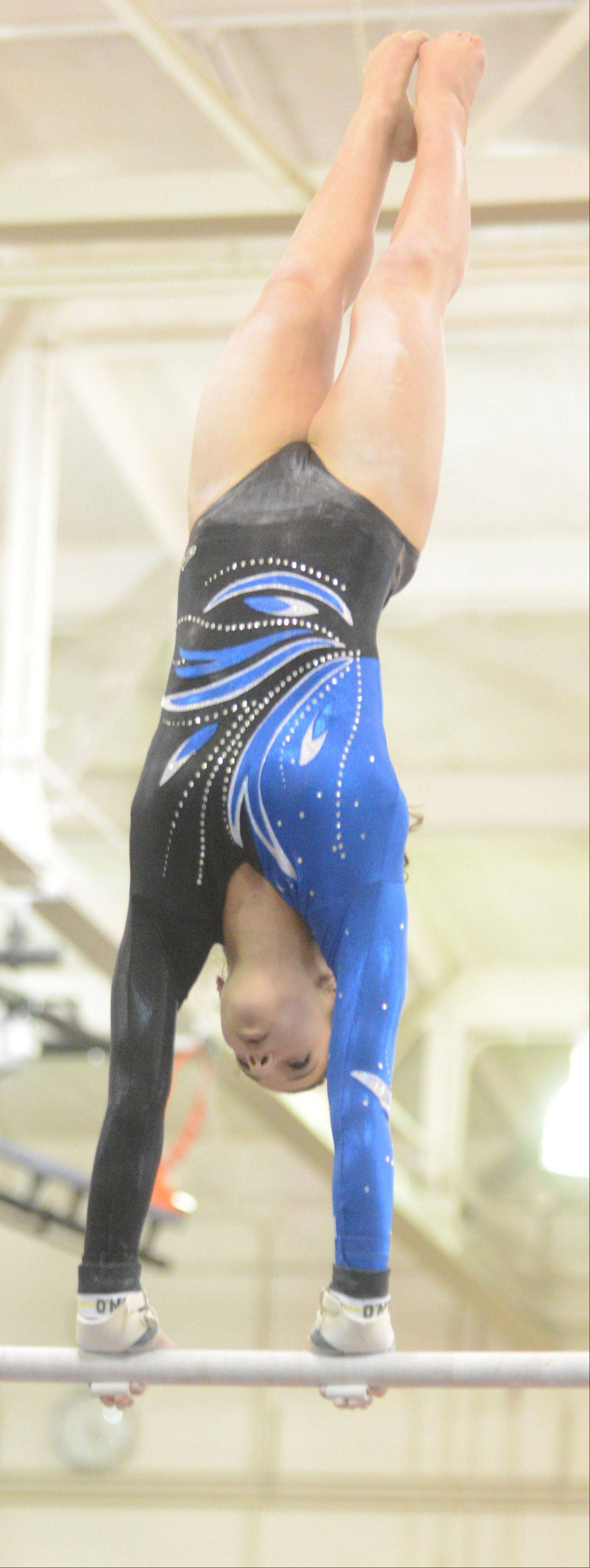 Grace Ginsberg of Geneva competes on the bars.