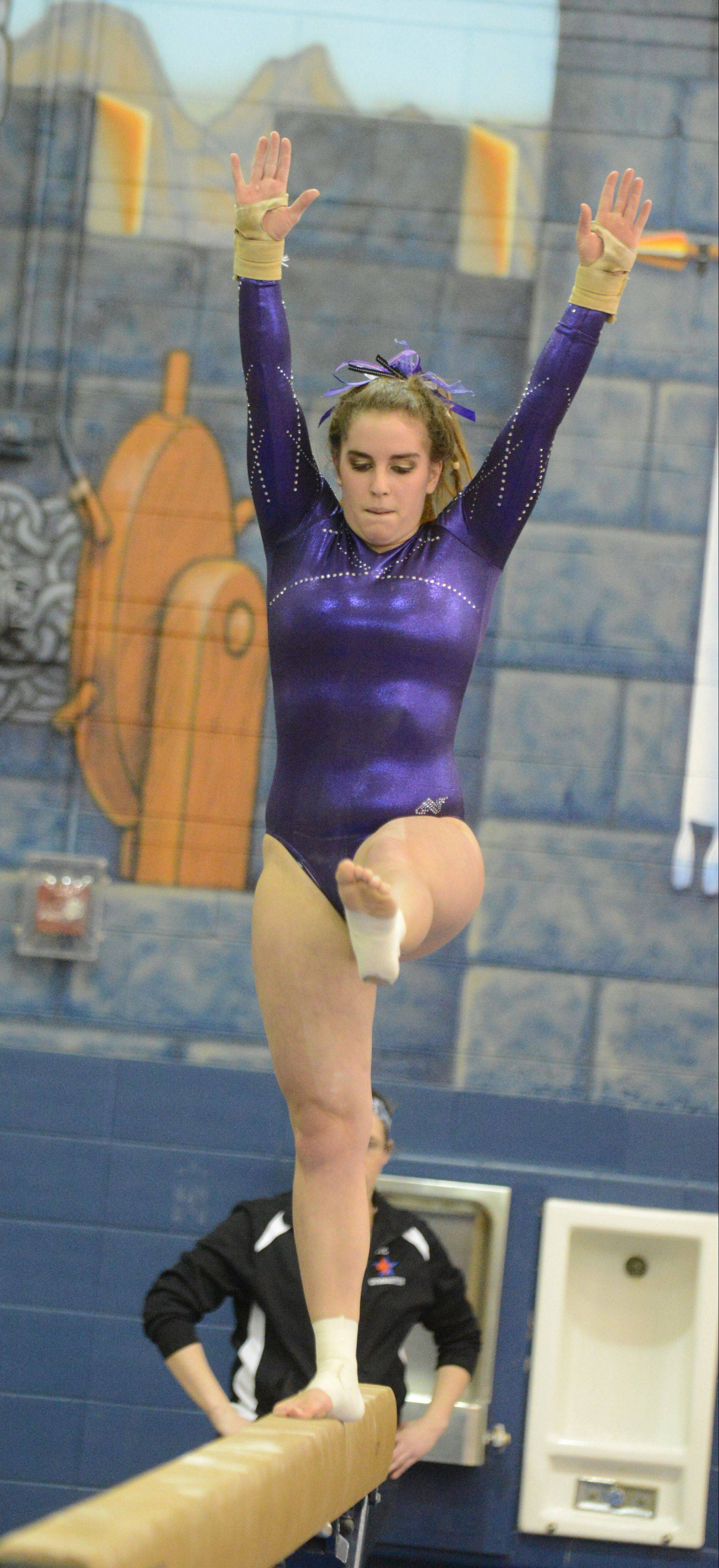 Alix Scherer of St. Charles co-op takes her turn on the beam at the Upstate Eight gymnastics meet at Lake Park Saturday.