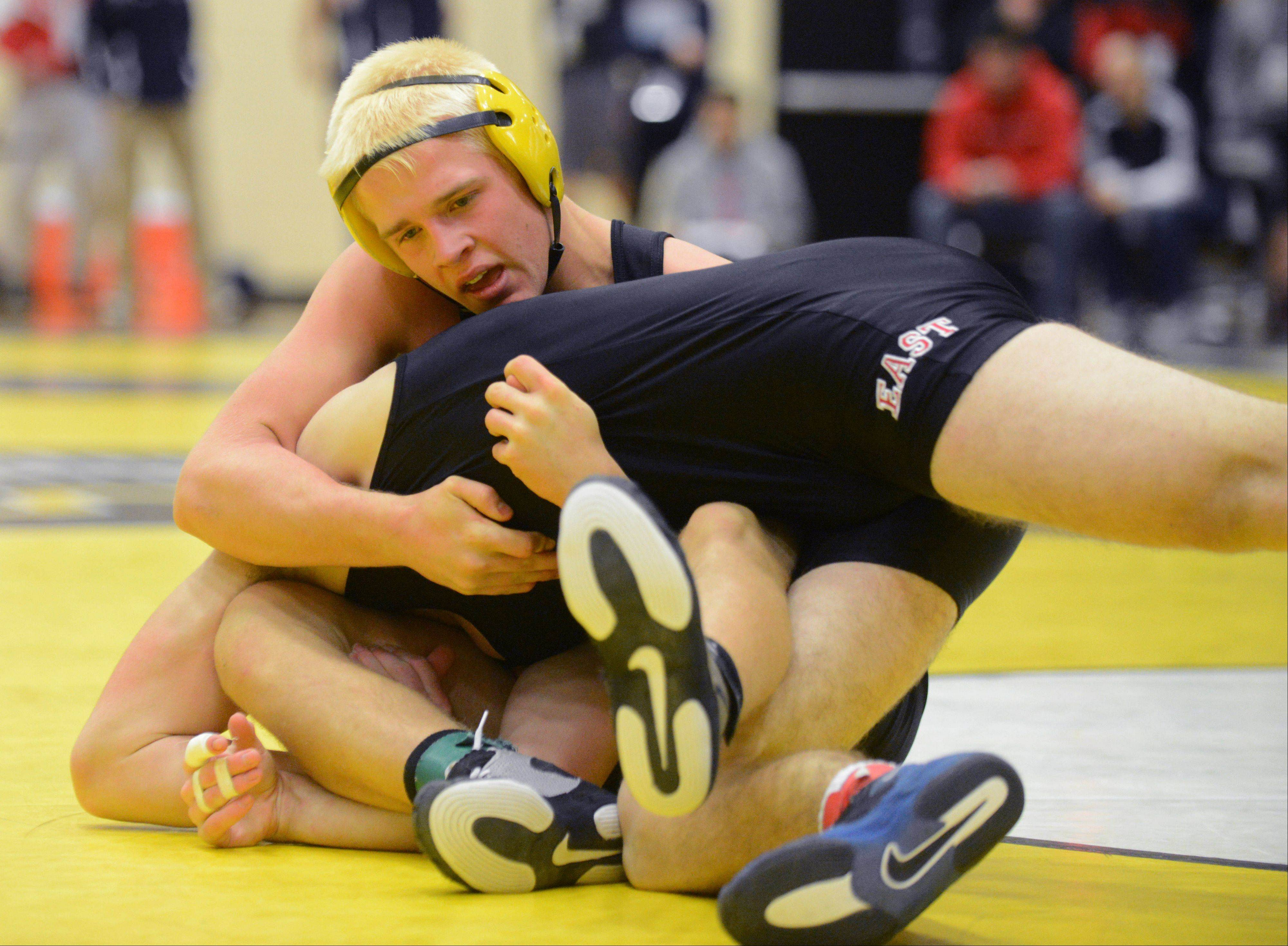 Colton Wegner of Glenbard North,top, and Jake Lueck of Glenbard East take part in a 170 pound match during the DuPage Valley Conference wrestling meet in Carol Stream Saturday.