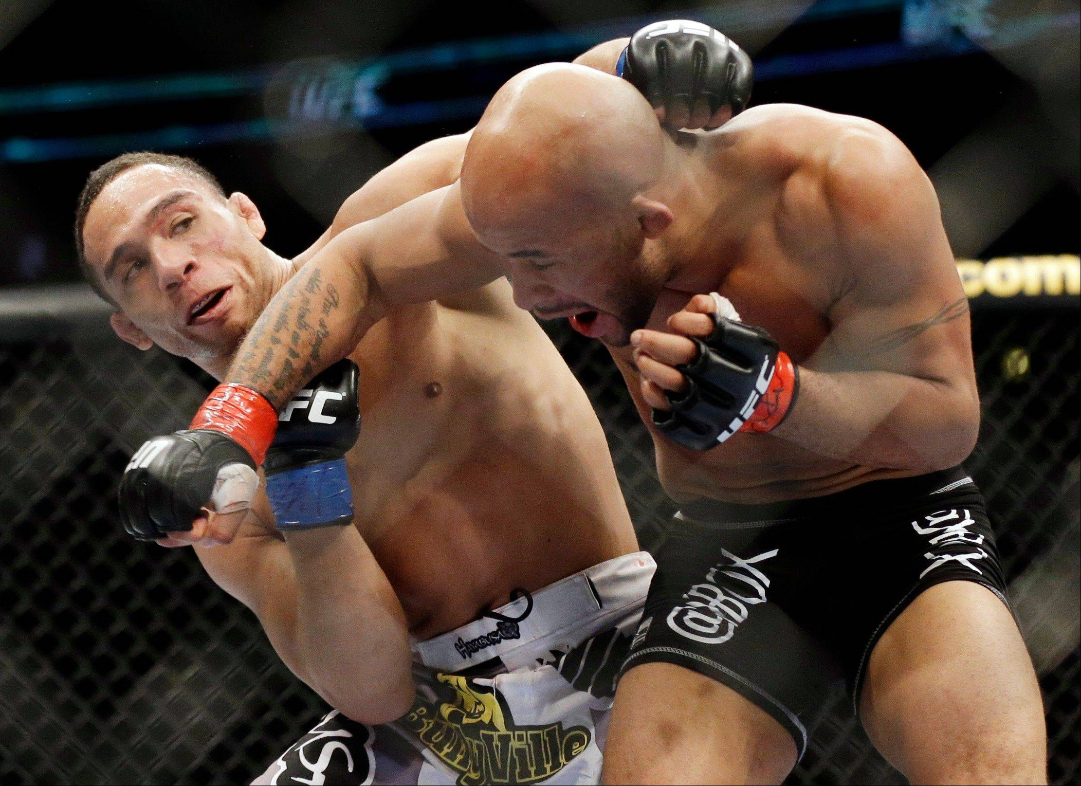 John Dodson, left, fights Demetrious Johnson during the UFC flyweight championship on FOX 6 at United Center in Chicago, Saturday, Jan. 26, 2013.