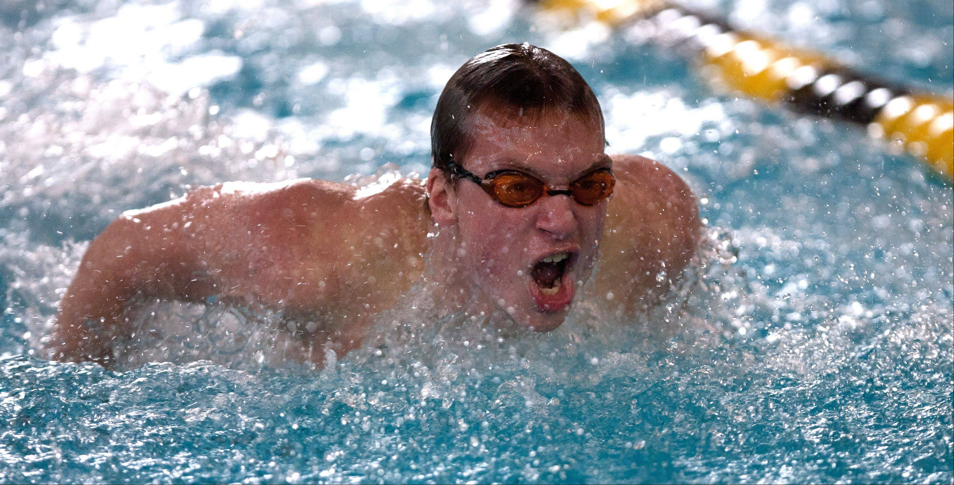 Kelvin Newton of Waubonsie Valley High School swims the 100 yard butterfly at the Mustang Swim and Dive Invite, hosted by Metea Valley High School.
