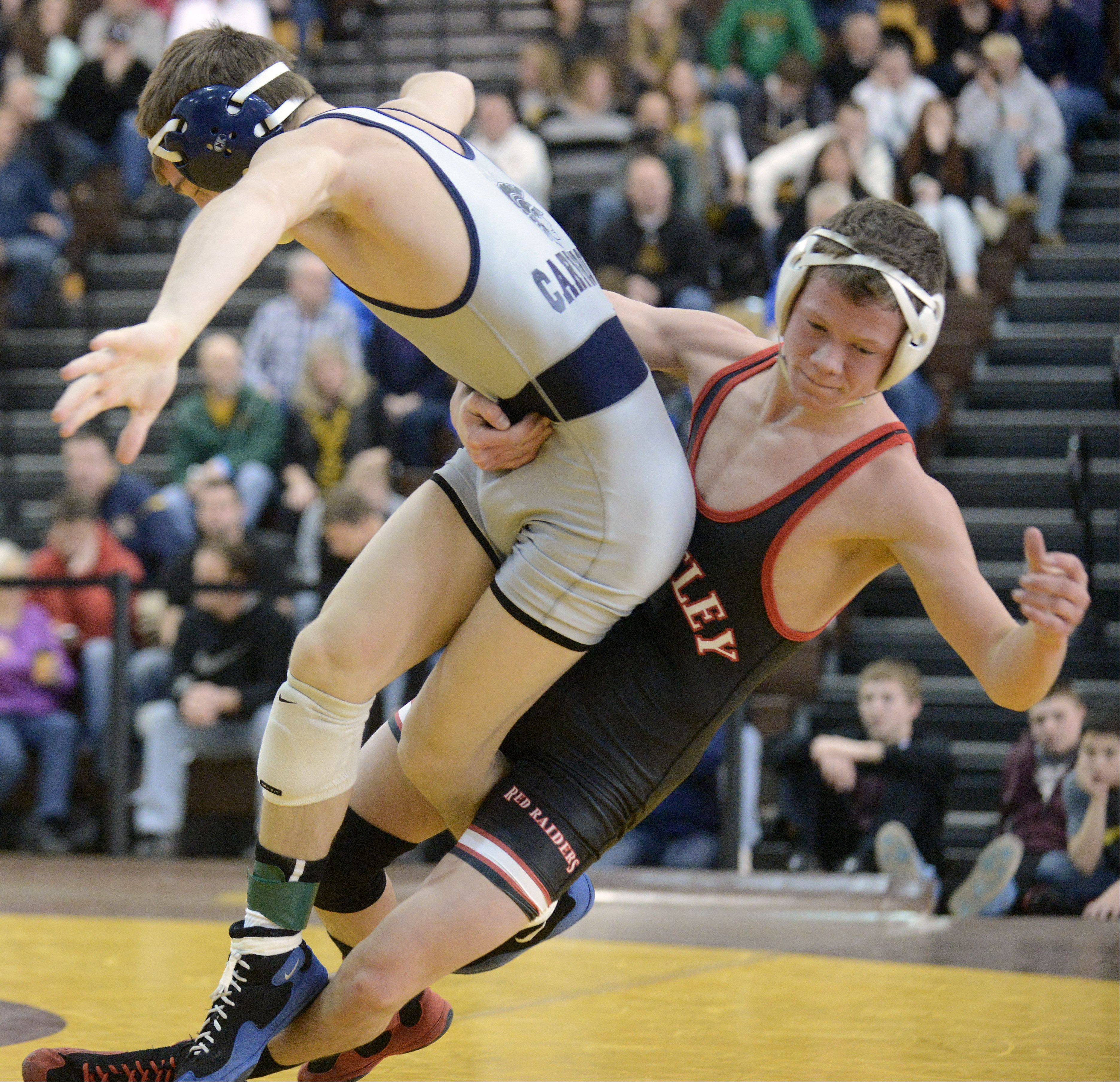 Cary-Grove's Michael Cullen is pulled down to the mat by Huntley's Zach Stenger in the 113-pound championship match at the Fox Valley Conference finals on Saturday. Cullen took the win.