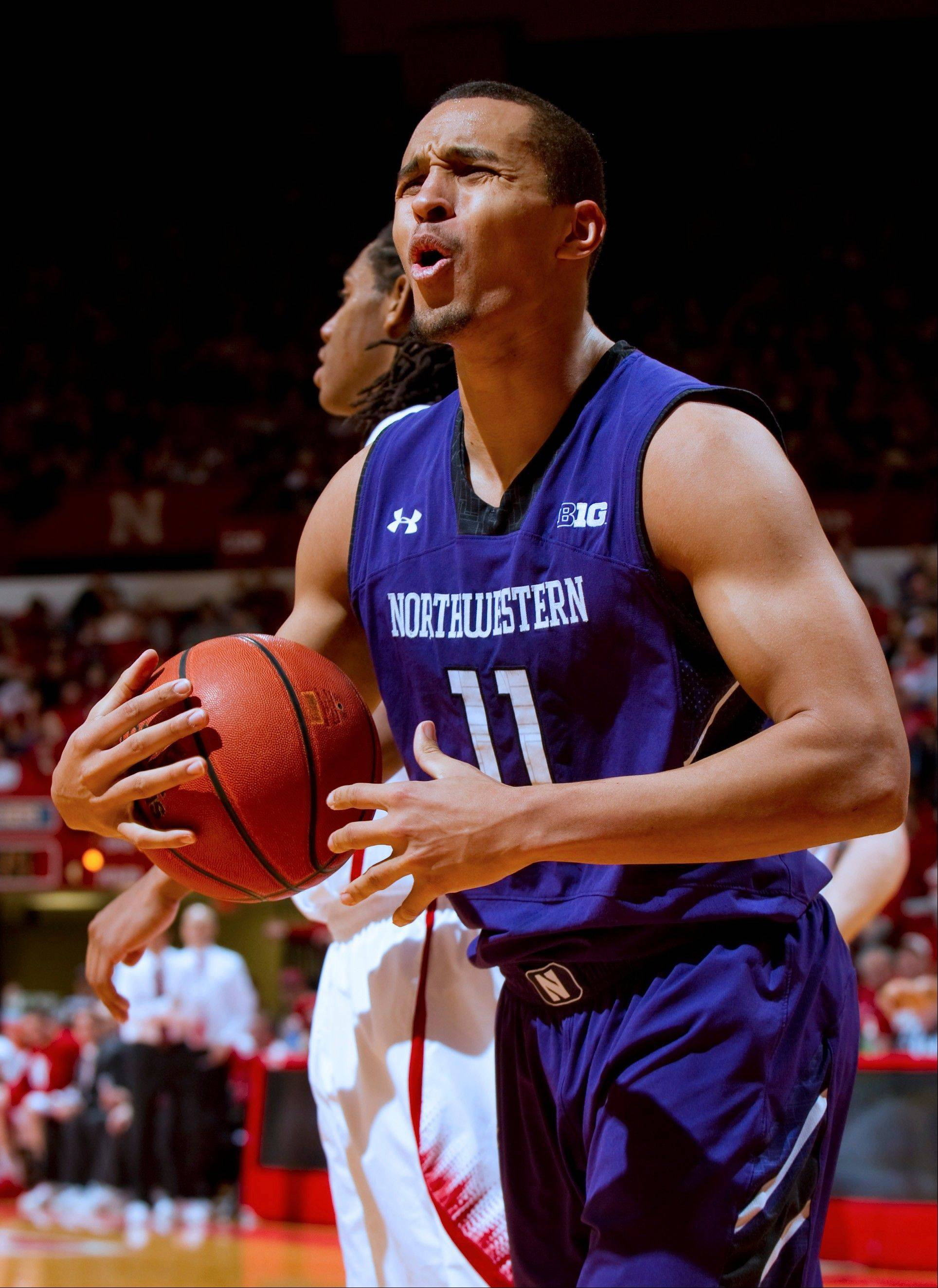 Northwestern's Reggie Hearn argues a call during the first half of his team's loss on Saturday.