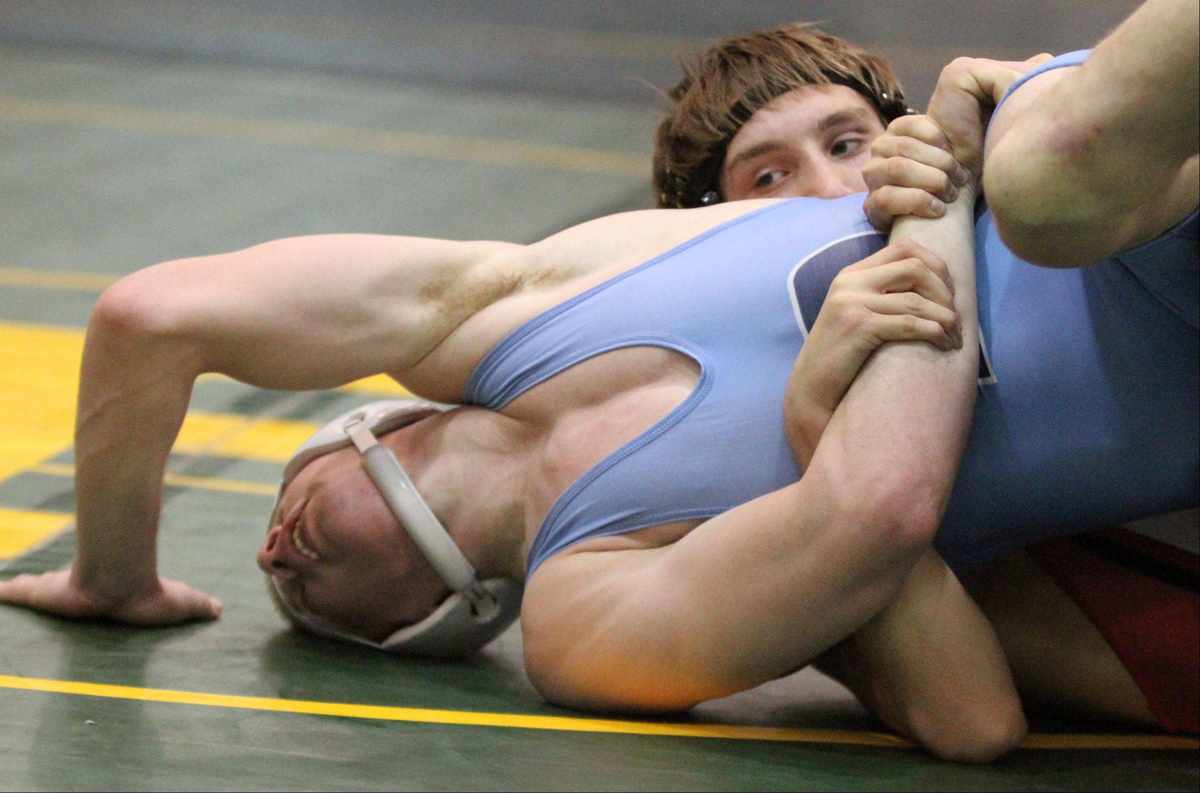 Barrington's Coord Wiseman, right, wins the 145-pound final match against Prospect's Brian Maigler at the Mid-Suburban League championships at Fremd on Saturday.