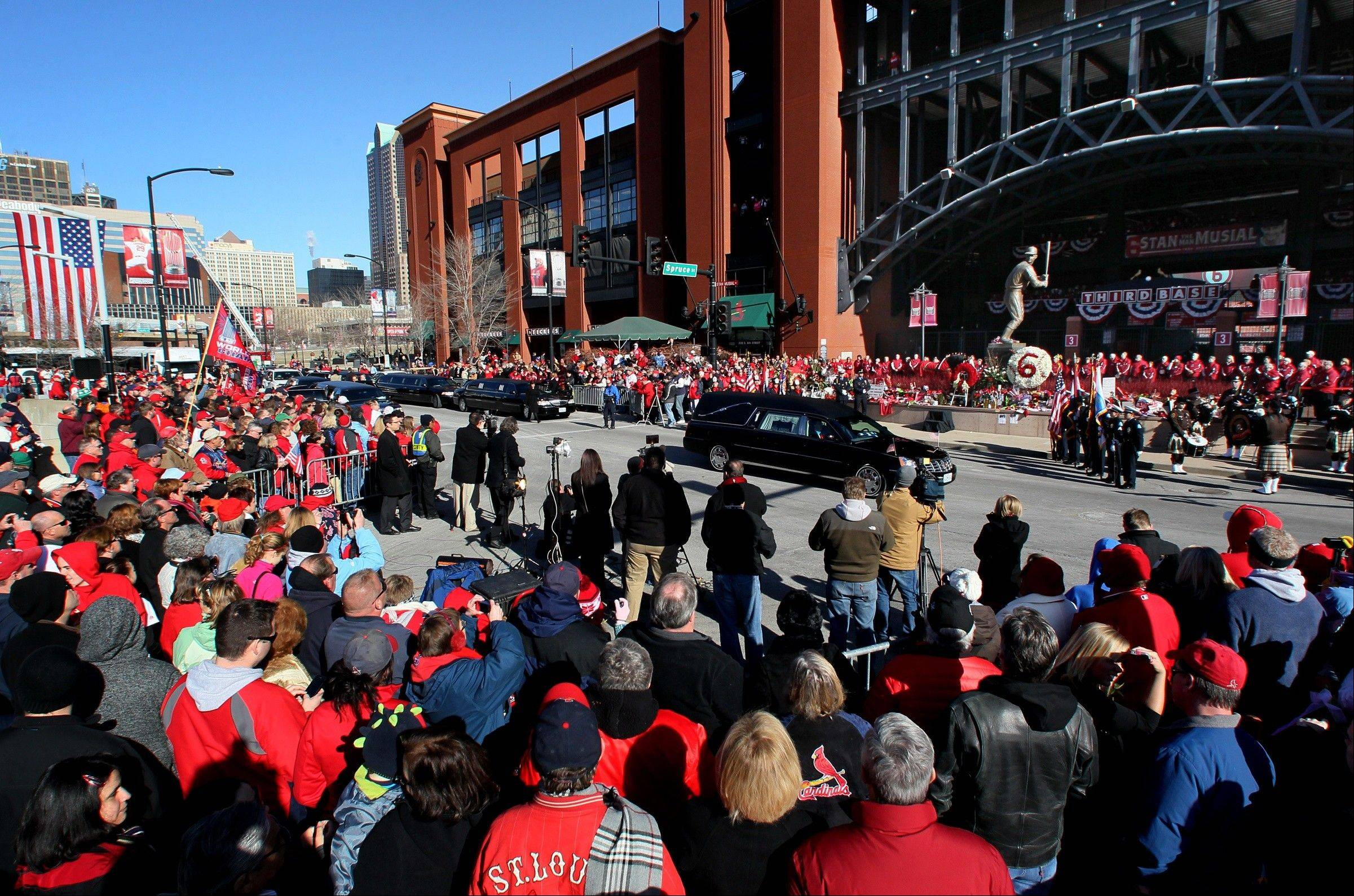 The hearse carrying Stan Musial stops in front of his statue outside of Busch Stadium for a wreath-laying ceremony after his funeral Saturday, Jan. 26, 2013.
