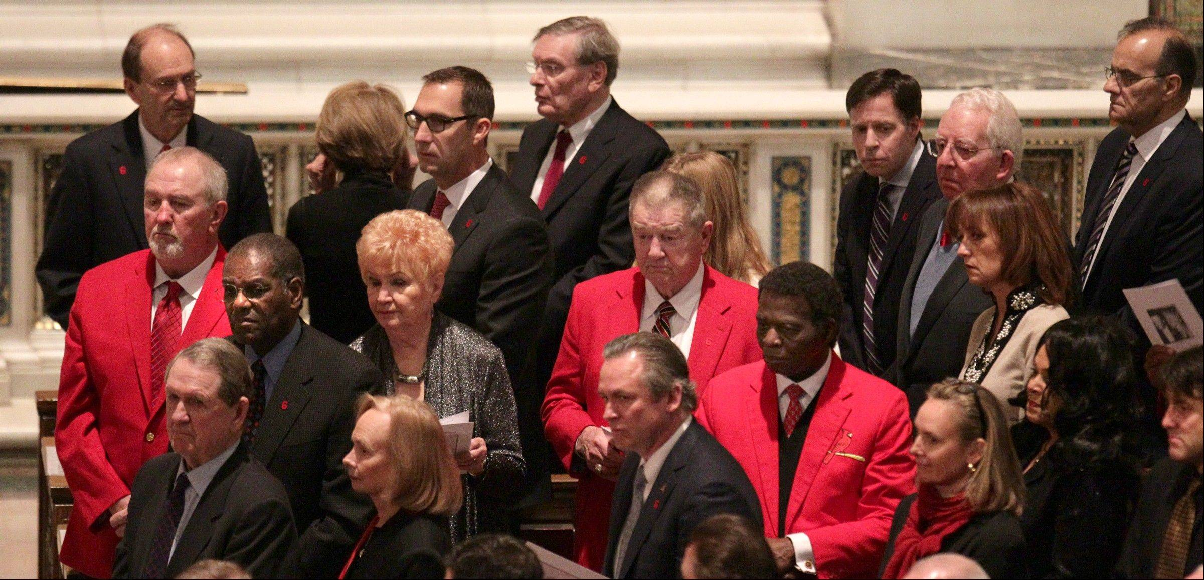 Mourners including former St. Louis Cardinals player and managers, Cardinals ownership and other baseball dignitaries, including commissioner Bud Selig, top center, watch the arrival of the casket of former St. Louis Cardinals baseball player Stan Musial as it arrives in the Cathedral Basilica of St. Louis for his Musial's funeral Mass on Saturday, Jan. 26, 2013 in St. Louis. Musial died Saturday, Jan. 19, 2013. He was 92.