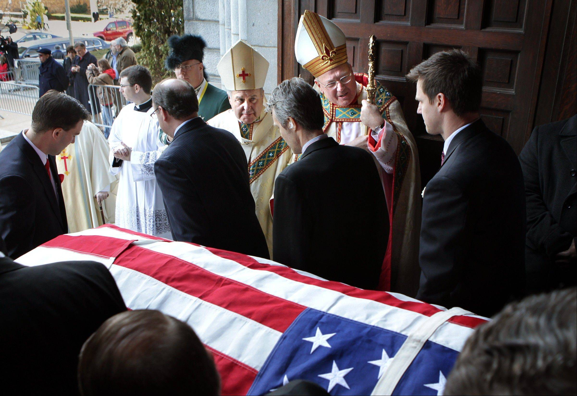 Cardinal Timothy Dolan, second from right, the Archbishop of New York, and St. Louis Archbishop Robert Carlson watch as pallbearers take the casket containing the body of former St. Louis Cardinals baseball player Stan Musial out of the Cathedral Basilica of St. Louis following Musial's funeral Mass on Saturday, Jan. 26, 2013 in St. Louis.