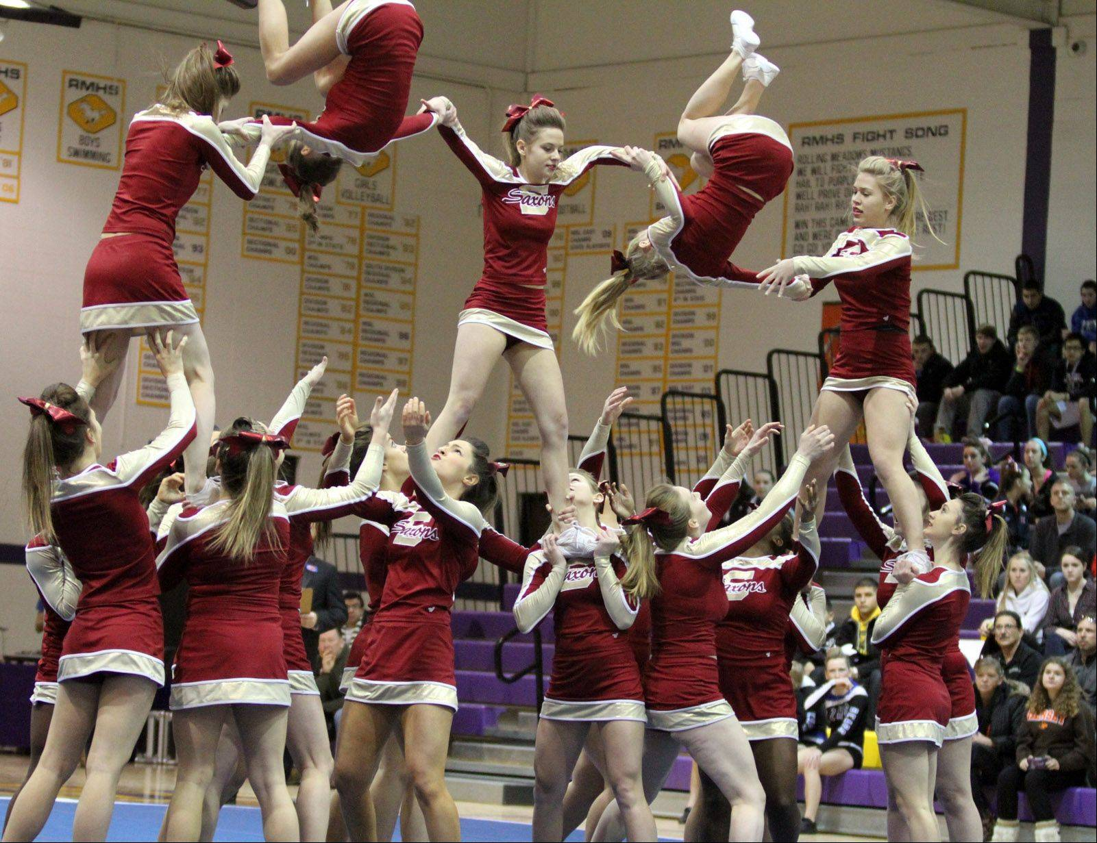 Schaumburg High School performs at the IHSA competitive cheerleading sectionals in Rolling Meadows on Saturday.