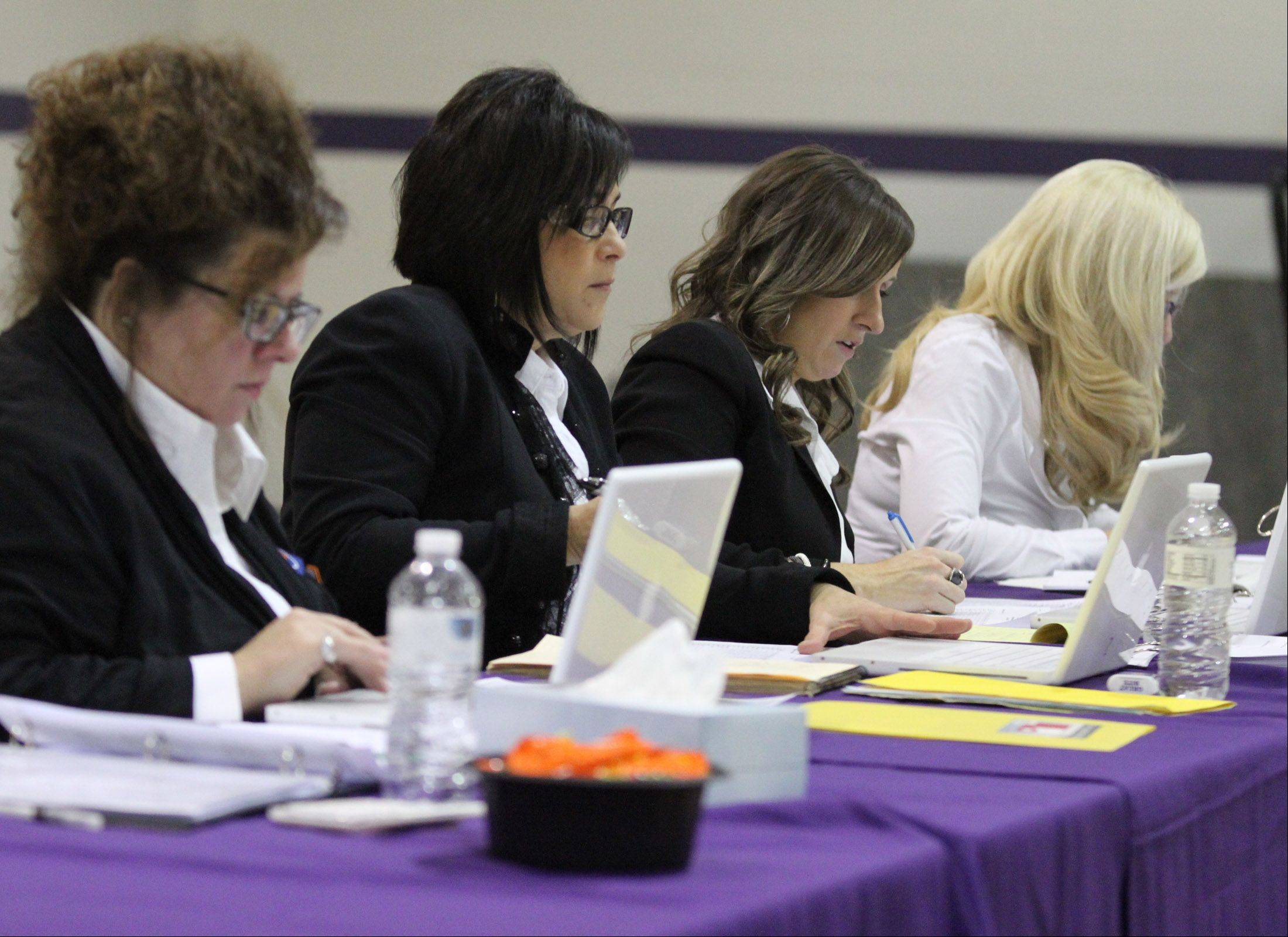 Judges at the IHSA competitive cheerleading sectionals in Rolling Meadows on Saturday.