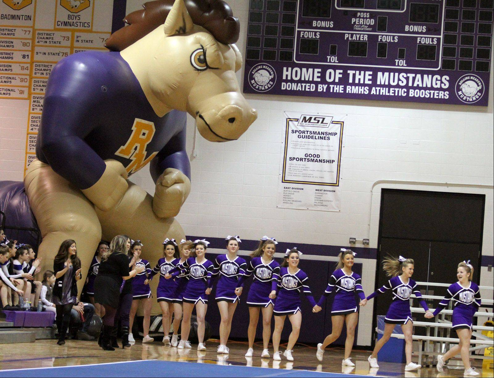 Rolling Meadows High School takes the floor at the IHSA competitive cheerleading sectionals in Rolling Meadows on Saturday.