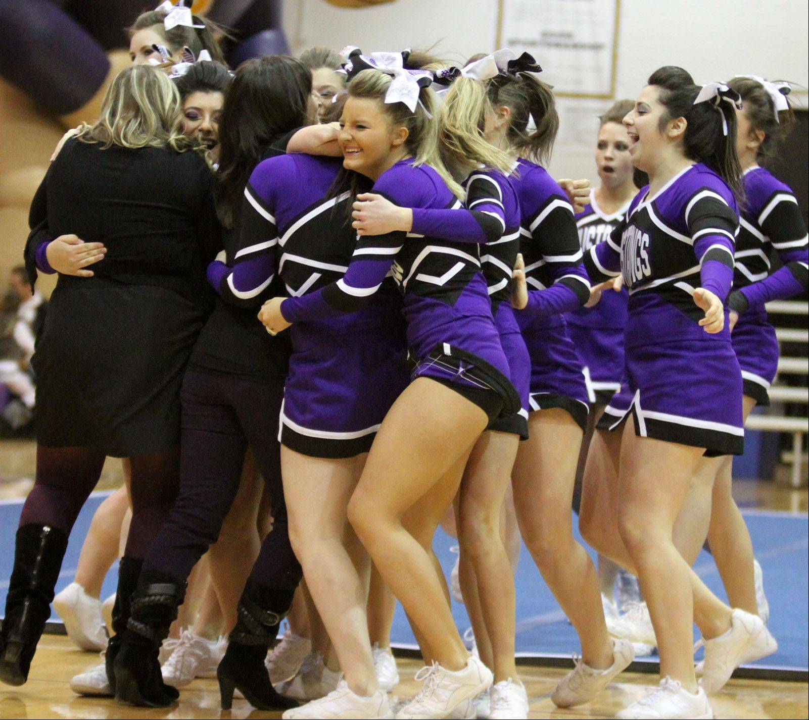Rolling Meadows High School celebrates their performance at the IHSA competitive cheerleading sectionals in Rolling Meadows on Saturday