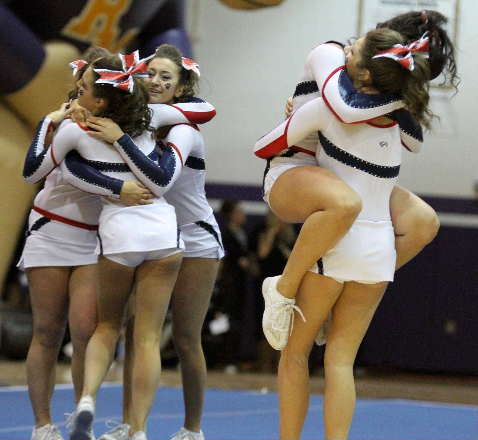 Conant High School celebrates their performance at the IHSA competitive cheerleading sectionals in Rolling Meadows on Saturday.