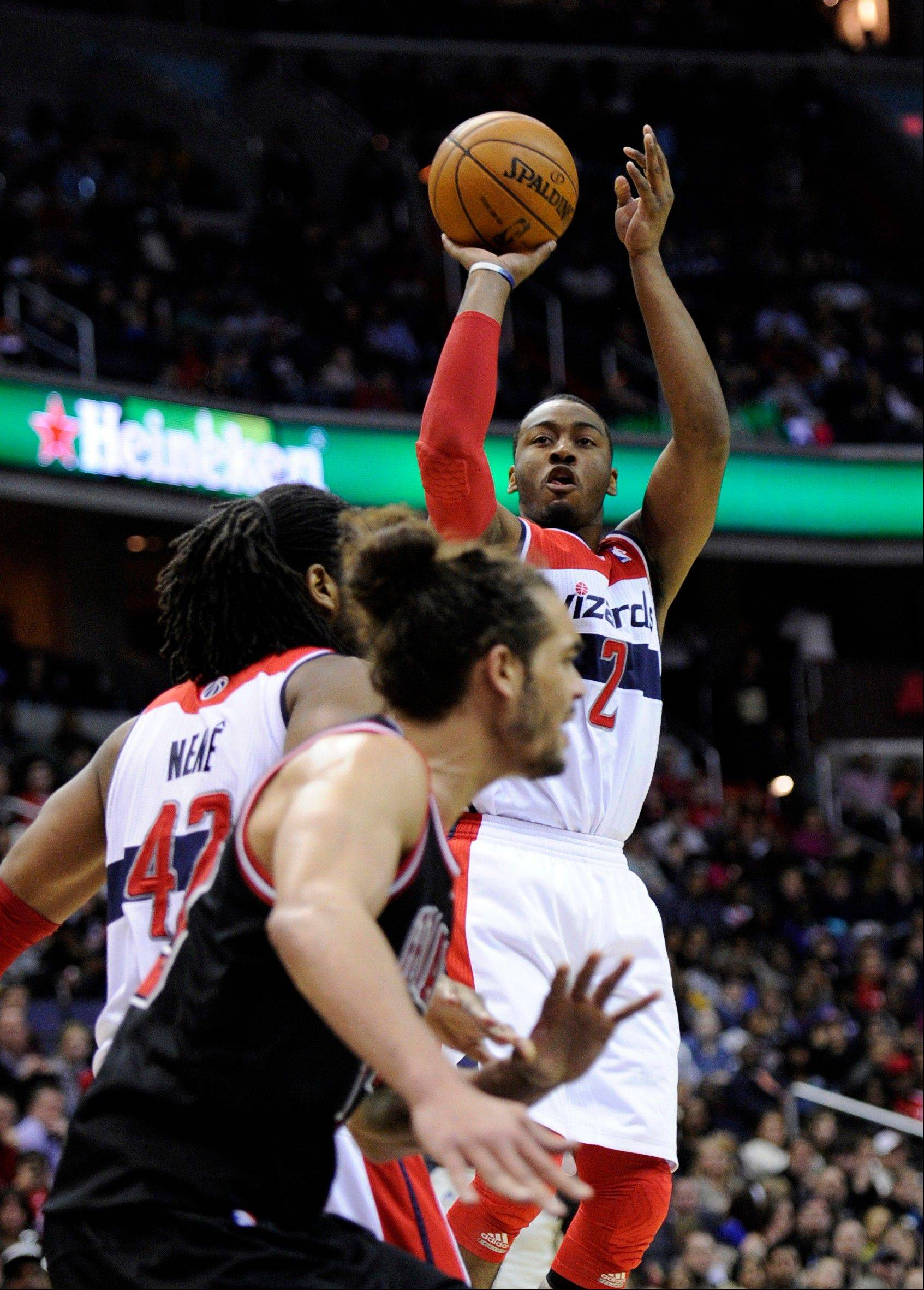 Wizards guard John Wall (2) puts up a shot against Bulls center Joakim Noah, front, during the second half of an NBA basketball game, Saturday, Jan. 26, 2013, in Washington. The Wizards won 86-73.