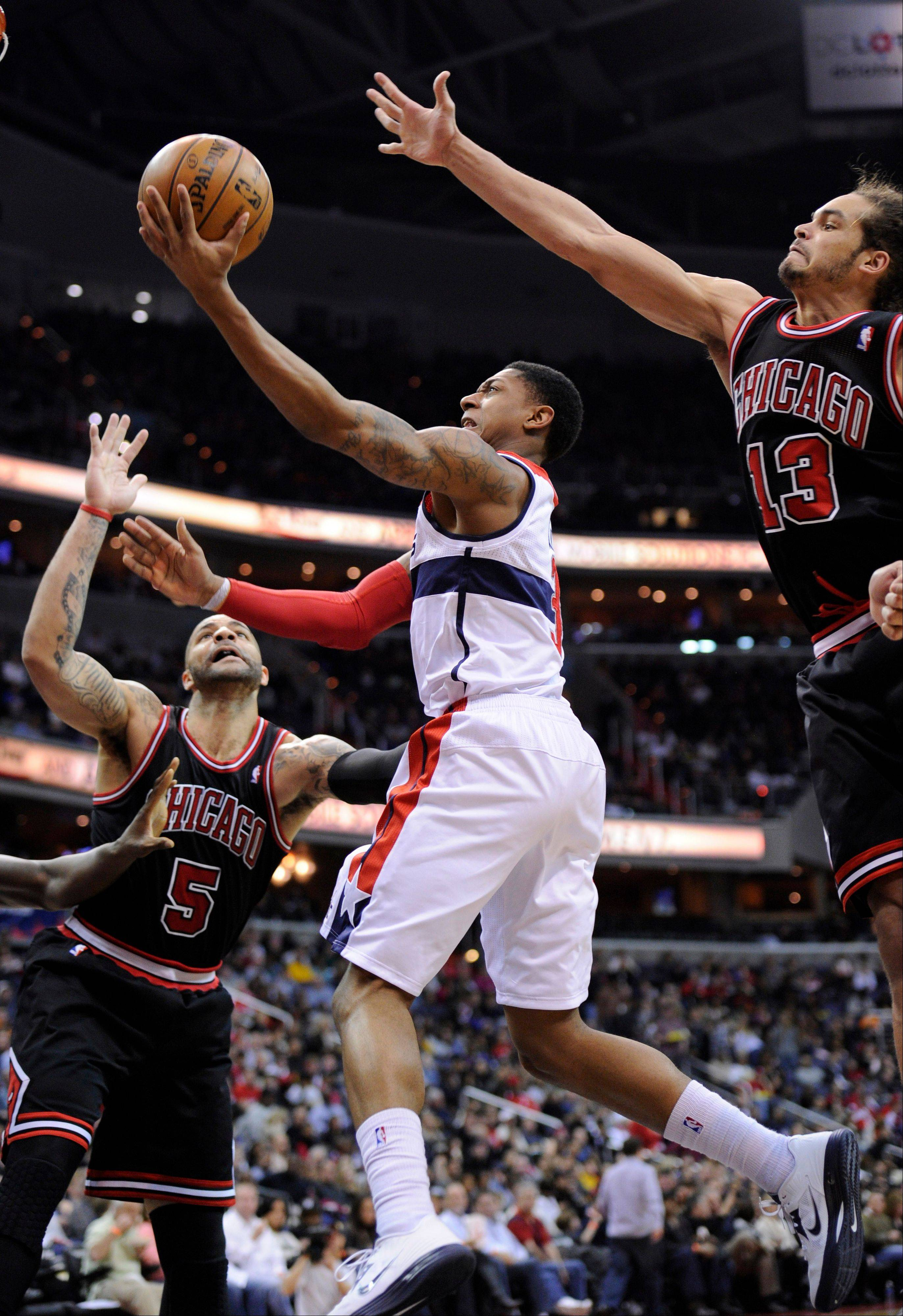 Bradley Beal, center, goes to the basket against Bulls forward Carlos Boozer (5) and center Joakim Noah (13) during the second half of an NBA basketball game, Saturday, Jan. 26, 2013, in Washington. The Wizards won 86-73.