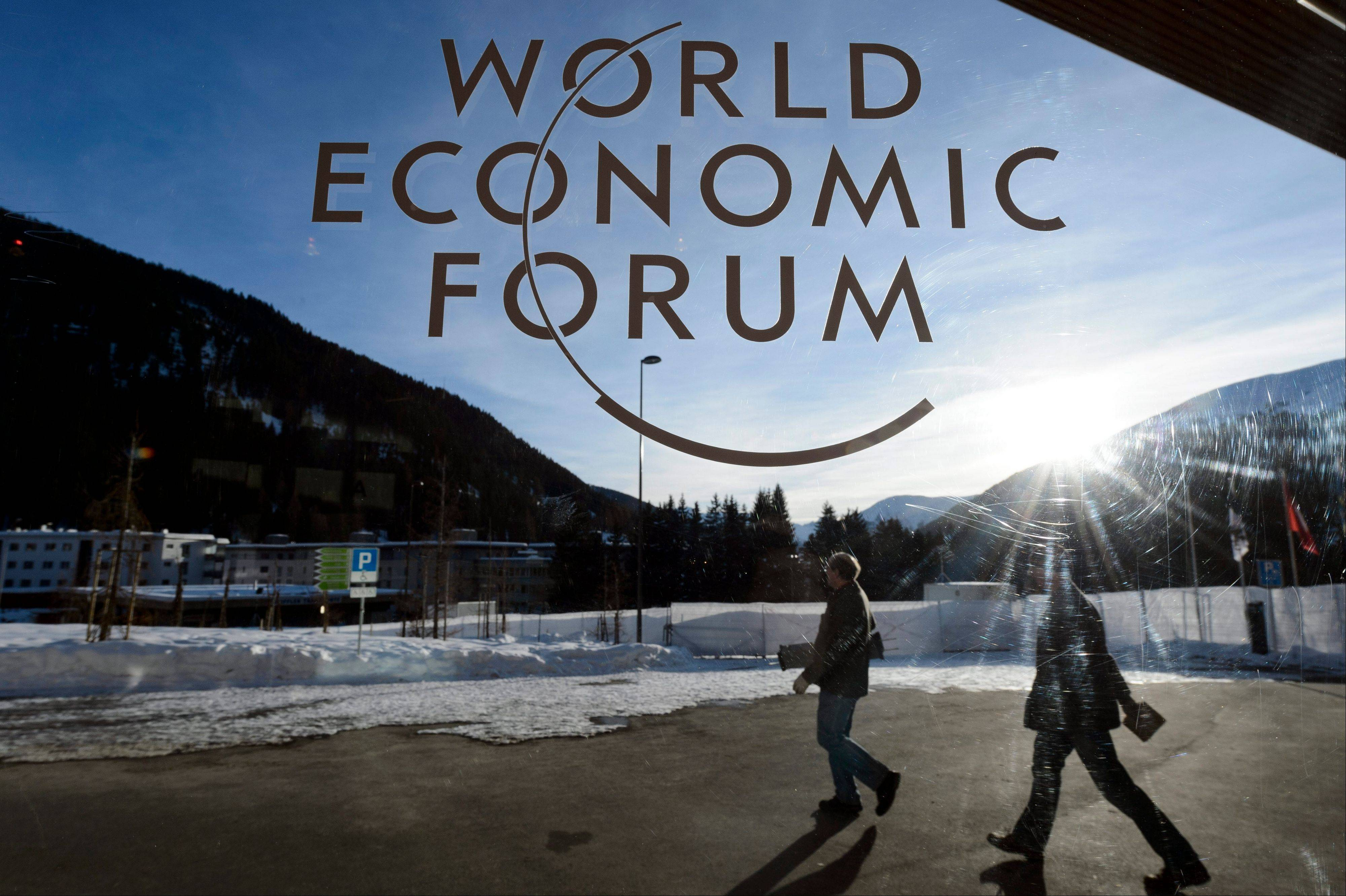 Participants leave the Congress Center the last day of the 43rd Annual Meeting of the World Economic Forum in Davos, Switzerland, Saturday.