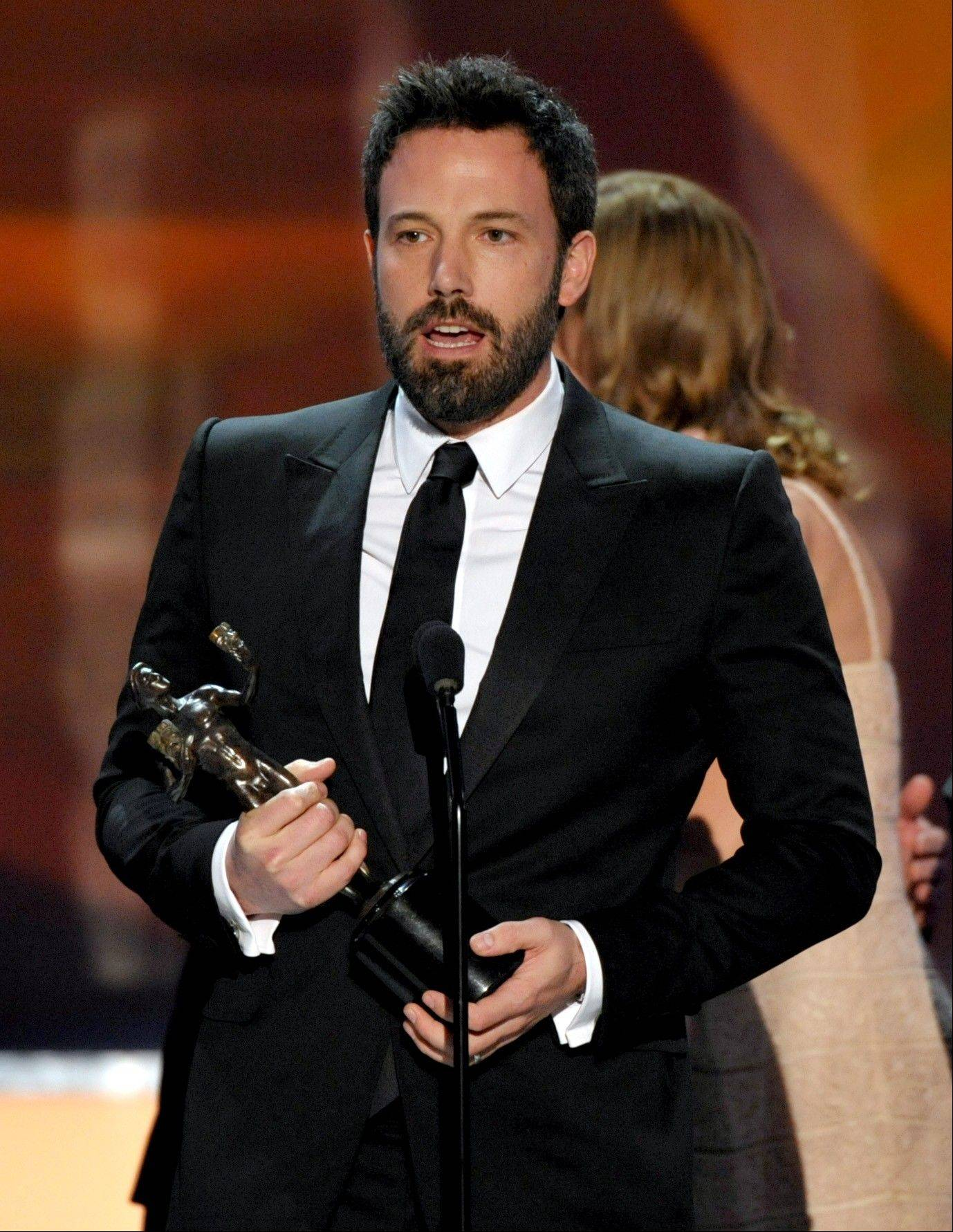 "Ben Affleck accepts the award for outstanding cast in a motion picture for ""Argo"" at the 19th Annual Screen Actors Guild Awards at the Shrine Auditorium in Los Angeles on Sunday Jan. 27, 2013."