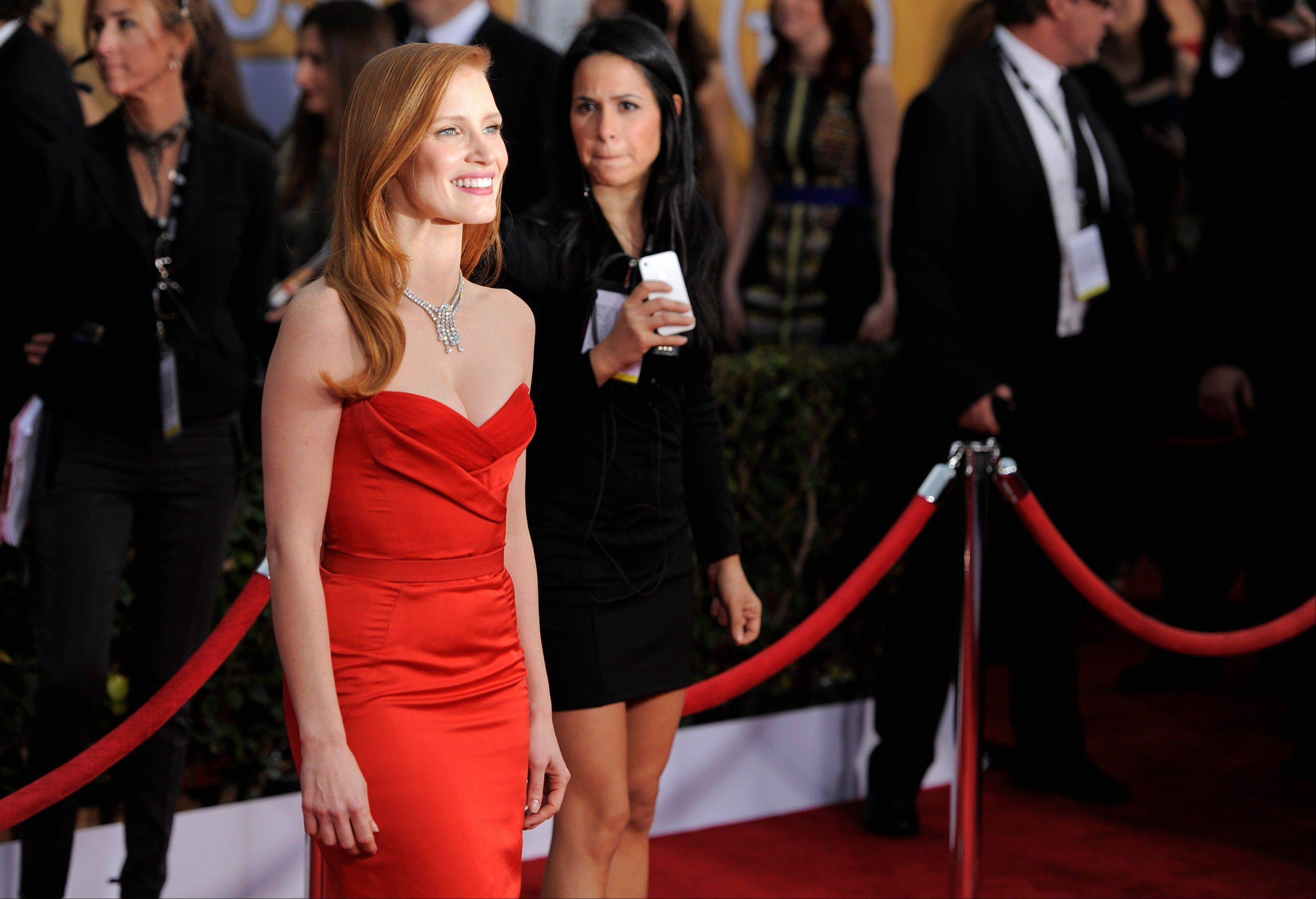 "Jessica Chastain, a nominee for Outstanding Performance by a Female Actor in a Leading Role for ""Zero Dark Thirty,"" arrives at the 19th Annual Screen Actors Guild Awards at the Shrine Auditorium in Los Angeles on Sunday, Jan. 27, 2013."