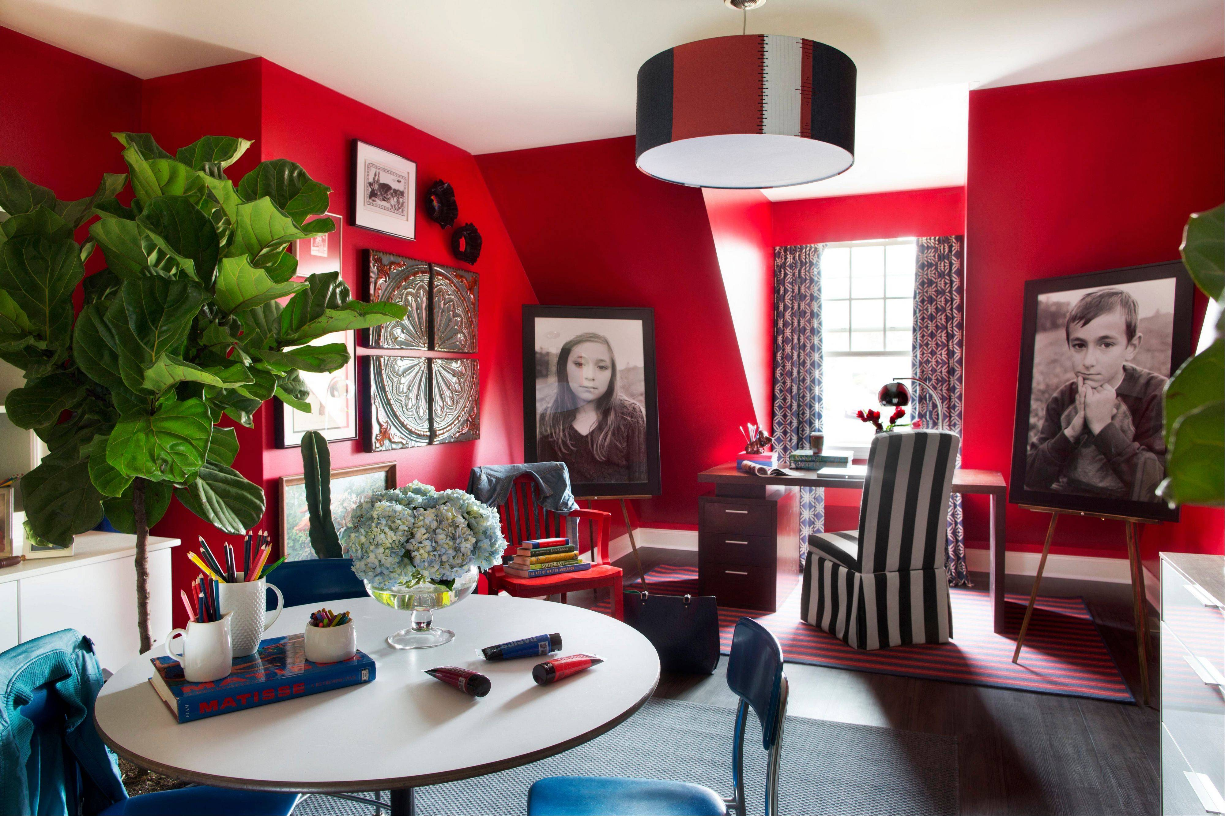 Designer Brian Patrick Flynn turned a disorganized catchall room into a colorful, creative space. Flynn uses bold color as a backdrop, then unites the disparate pieces with touches of the same accent color.