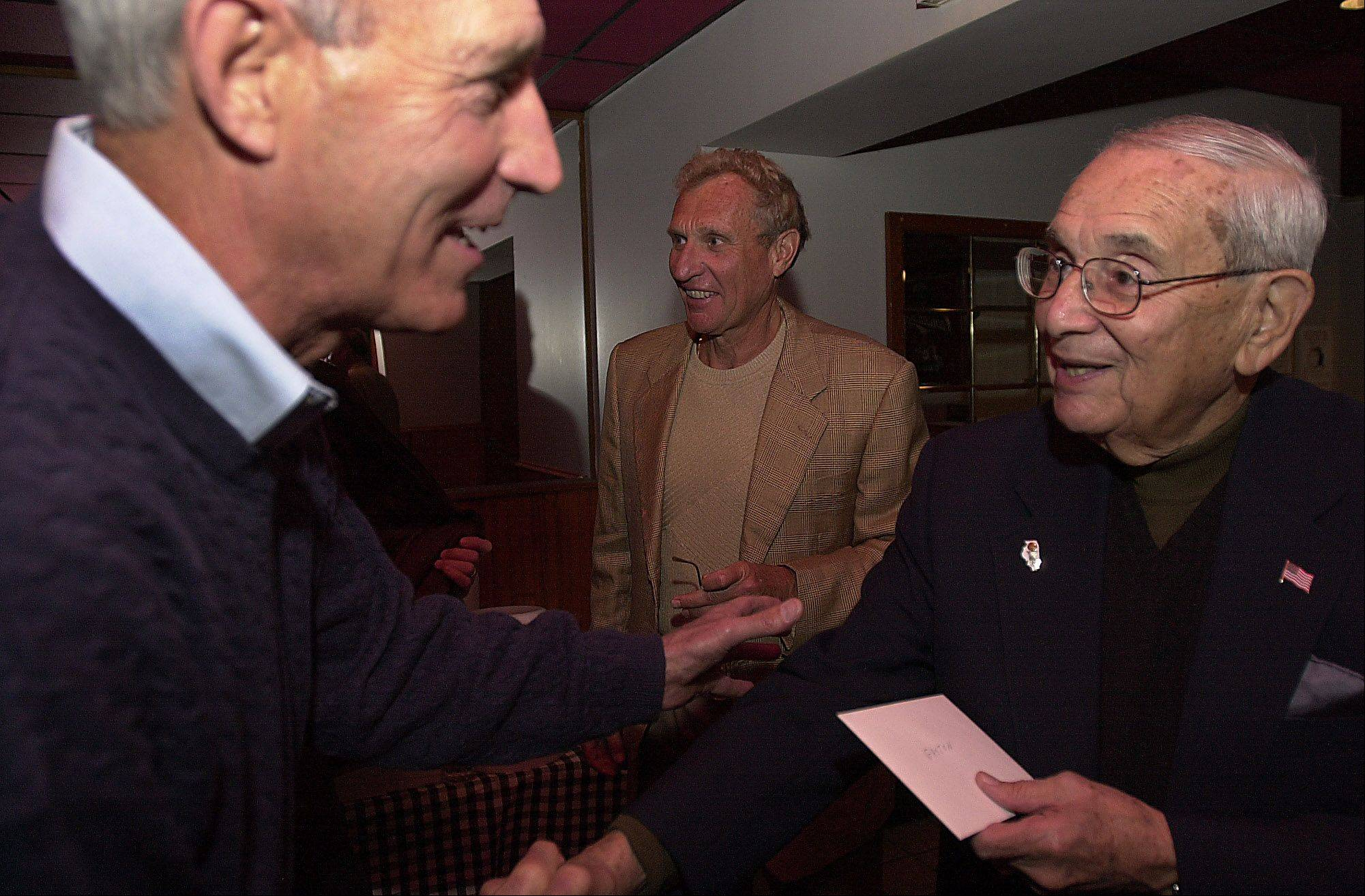 George Verber, left, says hello to his old coach, Gaston Freeman, at Freeman's 80th birthday party in 2002. Verber died last week after a four-year battle with leukemia.