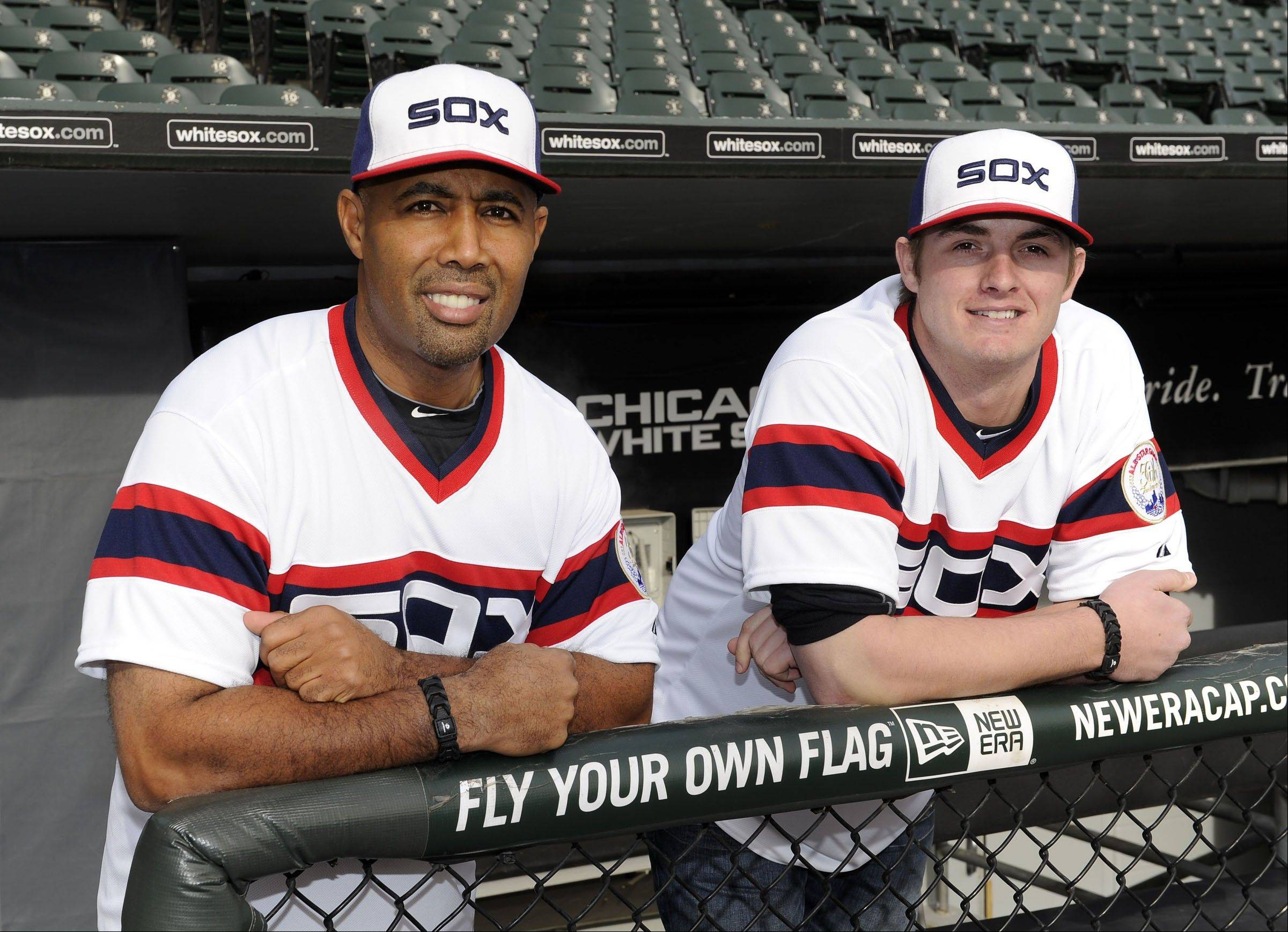 White Sox assistant hitting coach and former player Harold Baines, left, and pitcher Addison Reed show off the 1983 throwback uniforms the Sox will wear at Sunday home games in 2013.