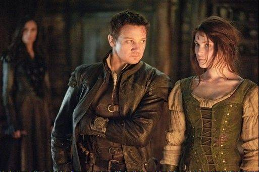 "This film image released by Paramount Pictures shows Jeremy Renner as Hansel and Gemma Arterton as Gretel in a scene from ""Hansel & Gretel: Witch Hunters."" The film brought in $19 million in its first weekend of release to capture the top spot at the box office."