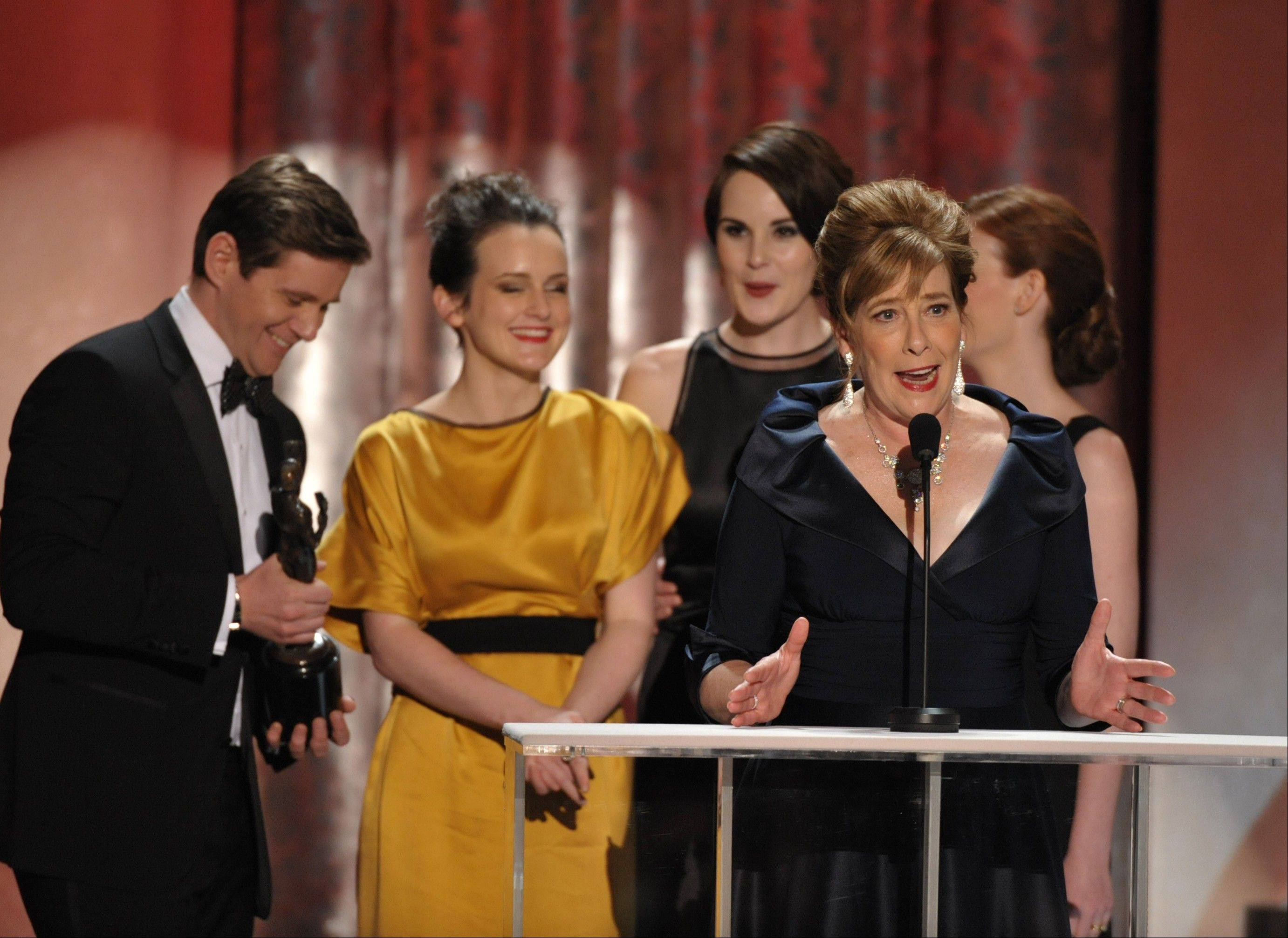 "Phyllis Logan accepts the award for outstanding ensemble in a drama series for ""Downton Abbey"" at the 19th Annual Screen Actors Guild Awards at the Shrine Auditorium in Los Angeles on Sunday Jan. 27, 2013."