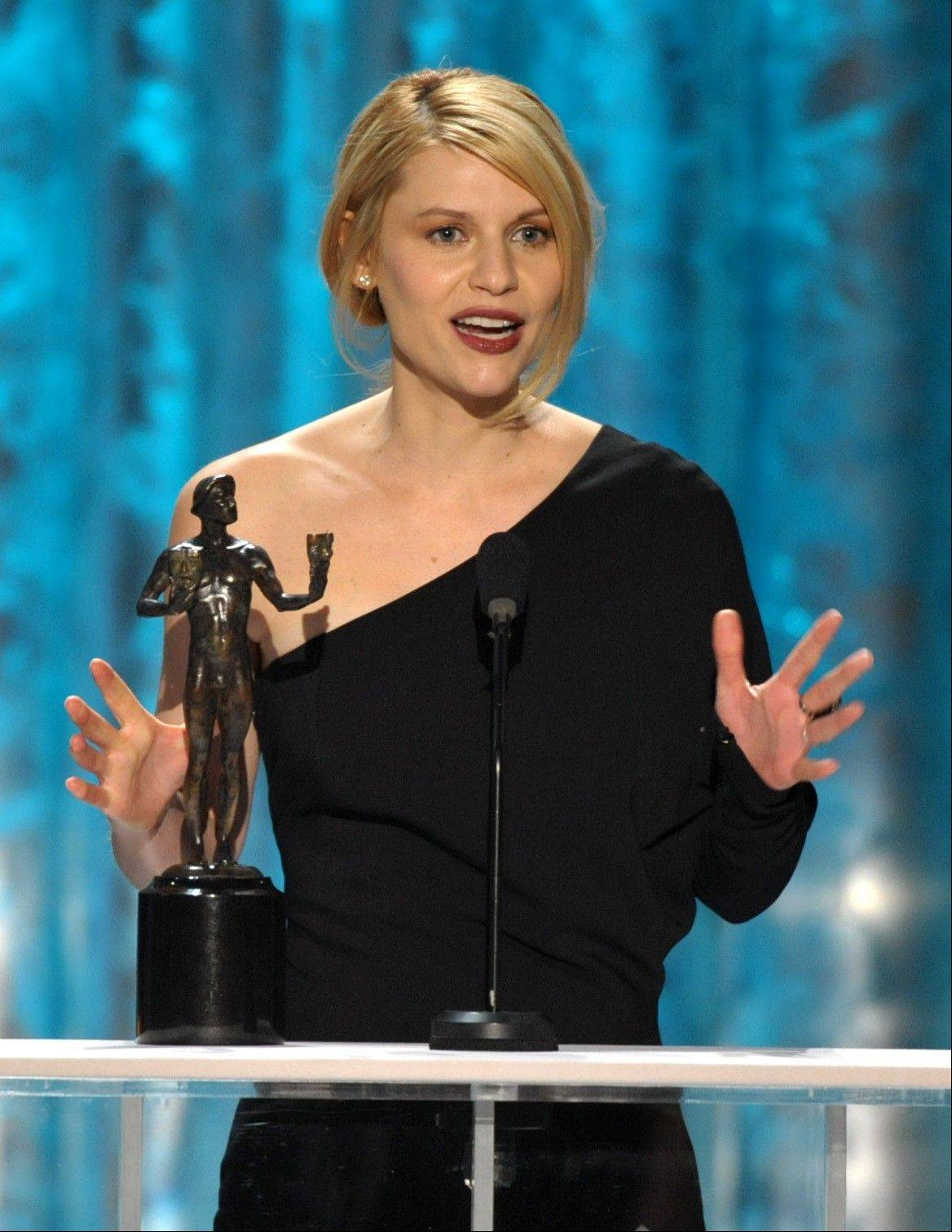 "Claire Danes accepts the award for outstanding female actor in a drama series for ""Homeland"" at the 19th Annual Screen Actors Guild Awards at the Shrine Auditorium in Los Angeles on Sunday Jan. 27, 2013."