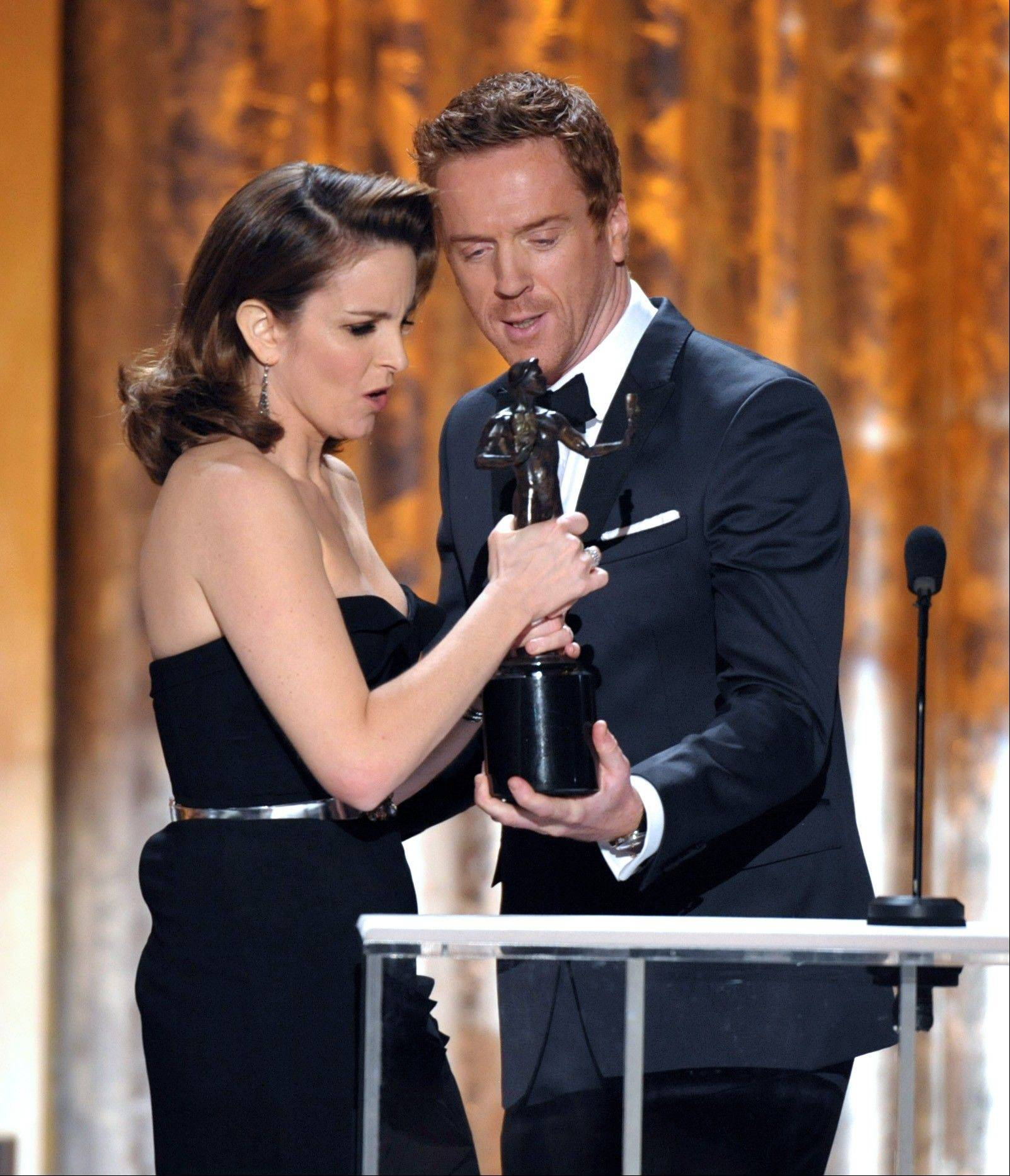 "Damian Lewis, right, presents the award for outstanding female actor in a comedy series to Tina Fey for ""30 Rock"" at the 19th Annual Screen Actors Guild Awards at the Shrine Auditorium in Los Angeles on Sunday Jan. 27, 2013."