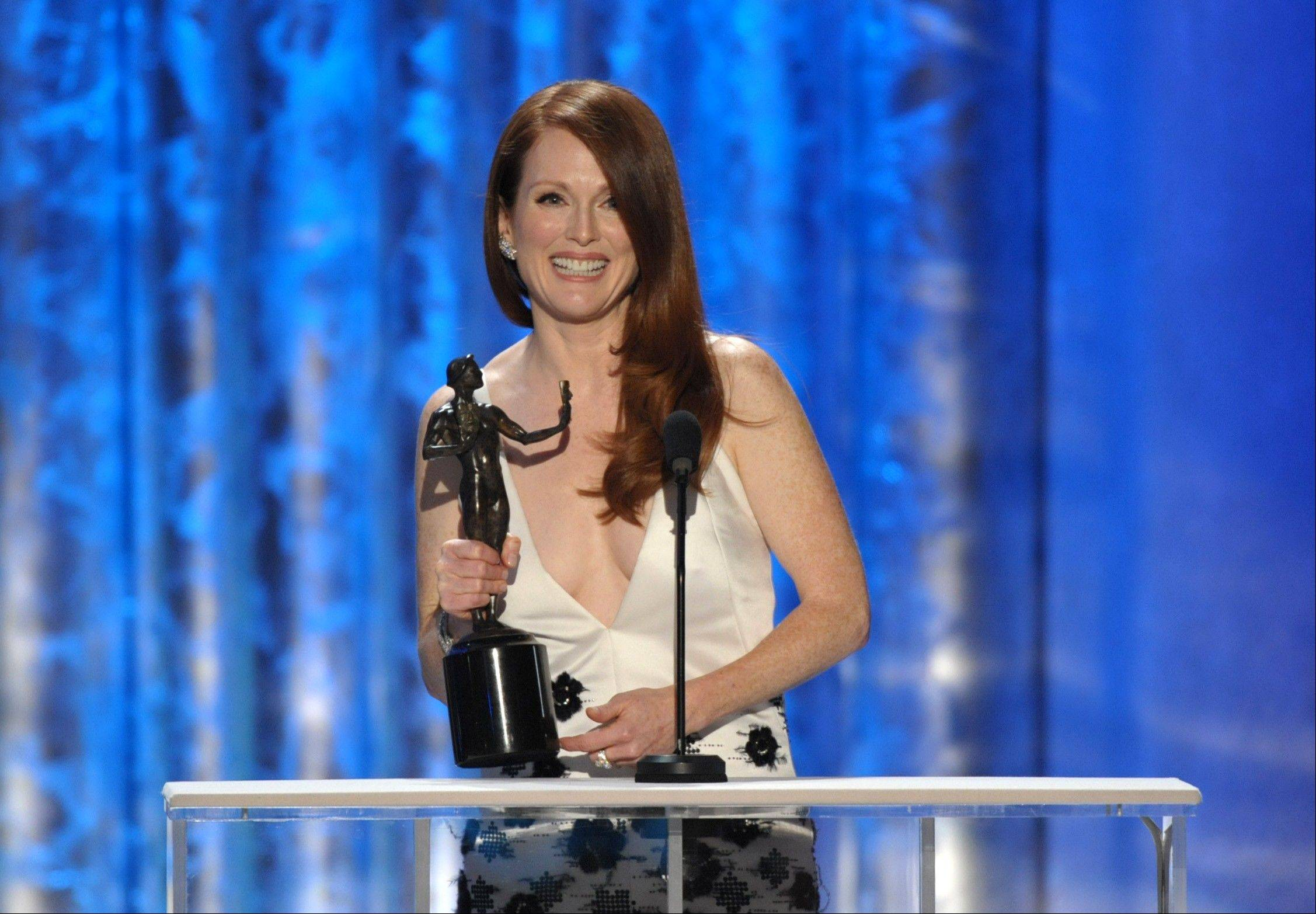 "Julianne Moore accepts the award for outstanding female actor in a TV movie or miniseries for ""Game Change"" at the 19th Annual Screen Actors Guild Awards at the Shrine Auditorium in Los Angeles on Sunday, Jan. 27, 2013."