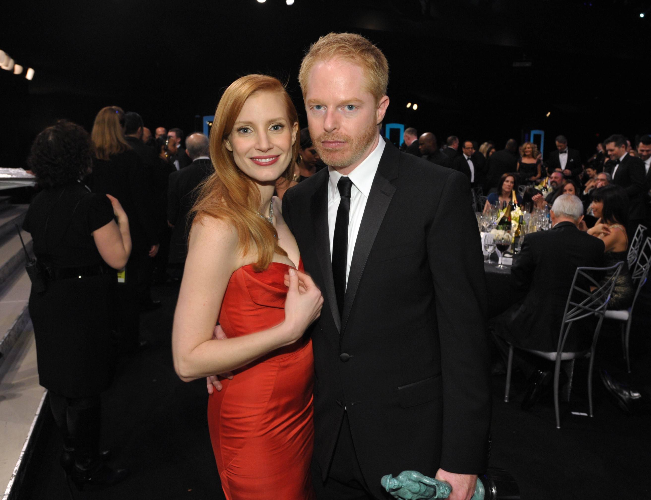 "Jessica Chastain hangs with Jesse Tyler Ferguson, who is holding his SAG Award for his role on ""Modern Family."""