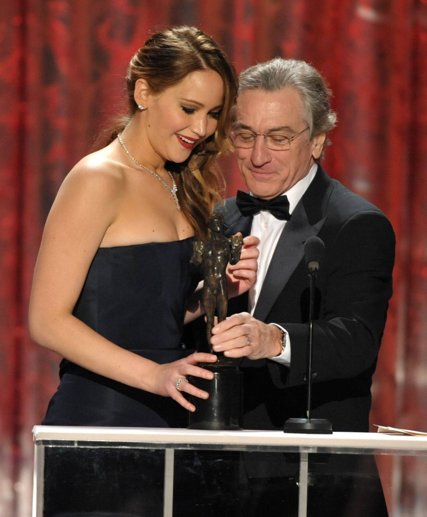 "Jennifer Lawrence accepts the SAG Award from Robert DeNiro for her role in ""Silver Linings Playlist."""