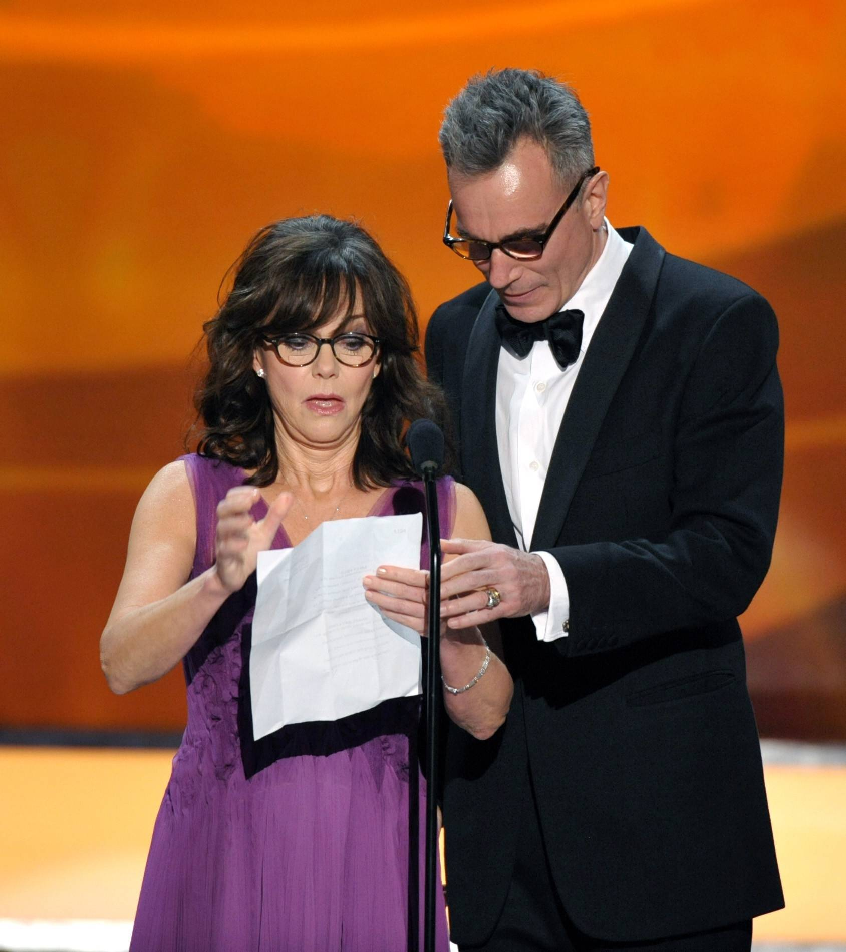 Sally Field gets a little help reading from Daniel Day-Lewis.