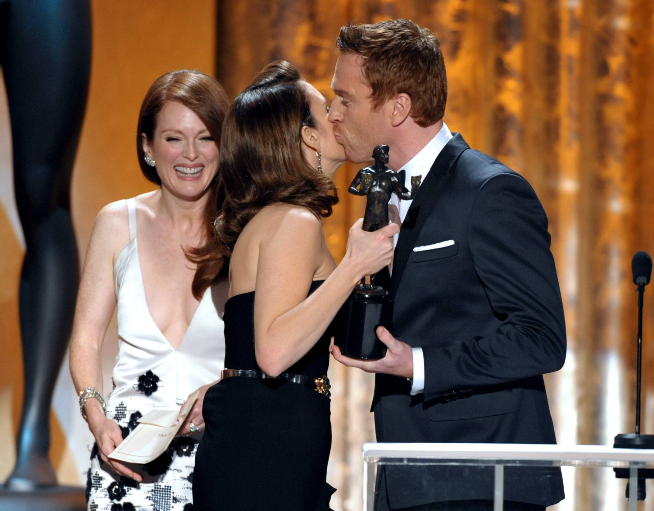 "Tina Fey gets her SAG Award from Damian Lewis and Julianne Moore. Fey won for her role as Liz Lemon on ""30 Rock."""
