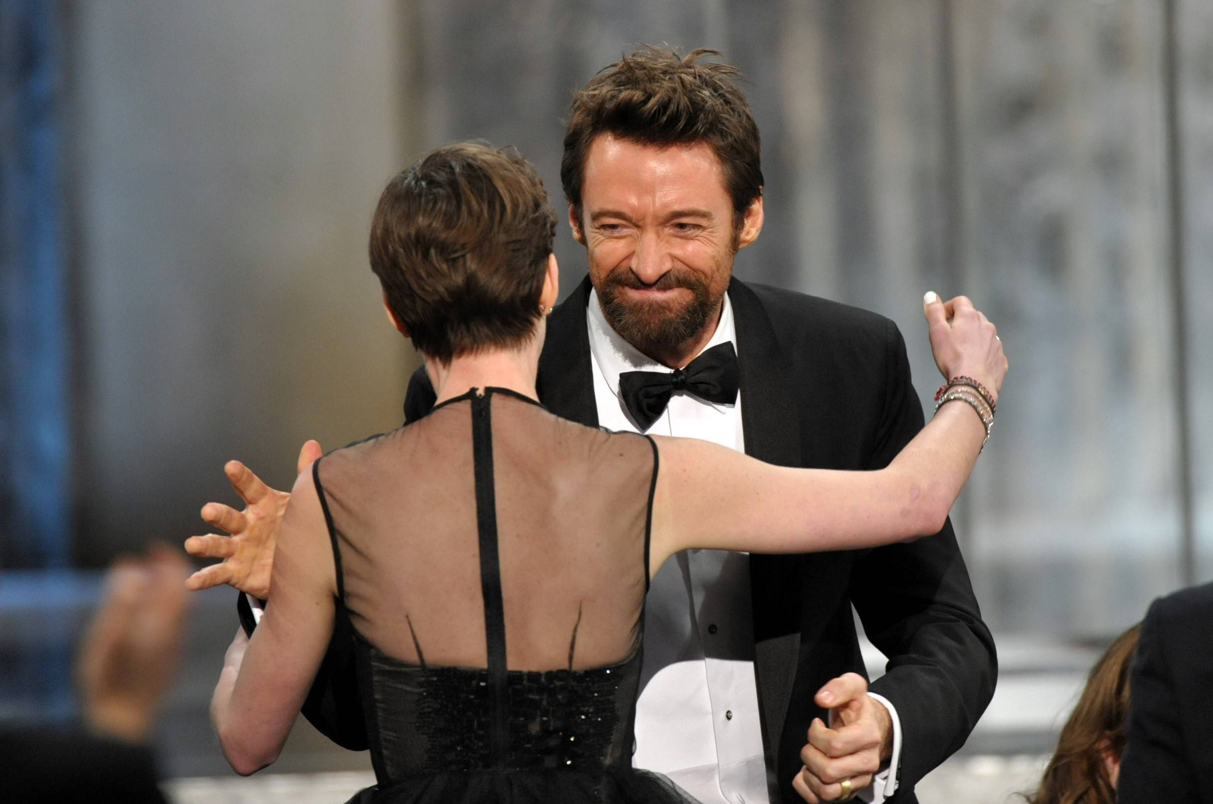 "Anne Hathaway gets a big hug from her ""Les Miserables"" co-star Hugh Jackman after winning the SAG for her role as Fantine."