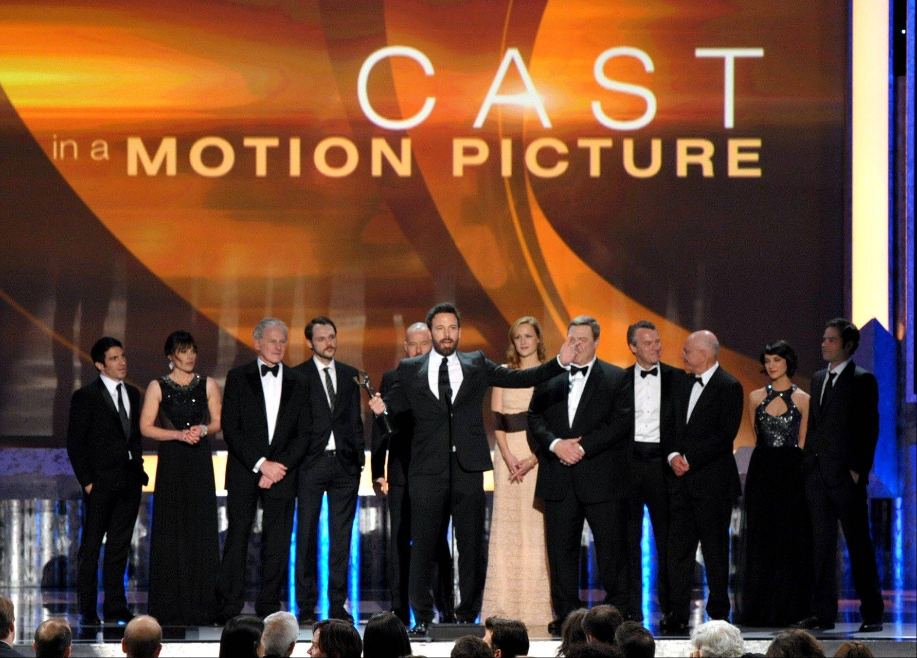"Ben Affleck, center, and the cast of ""Argo"" accept the award for outstanding cast in a motion picture for at the 19th Annual Screen Actors Guild Awards at the Shrine Auditorium in Los Angeles on Sunday Jan. 27, 2013."