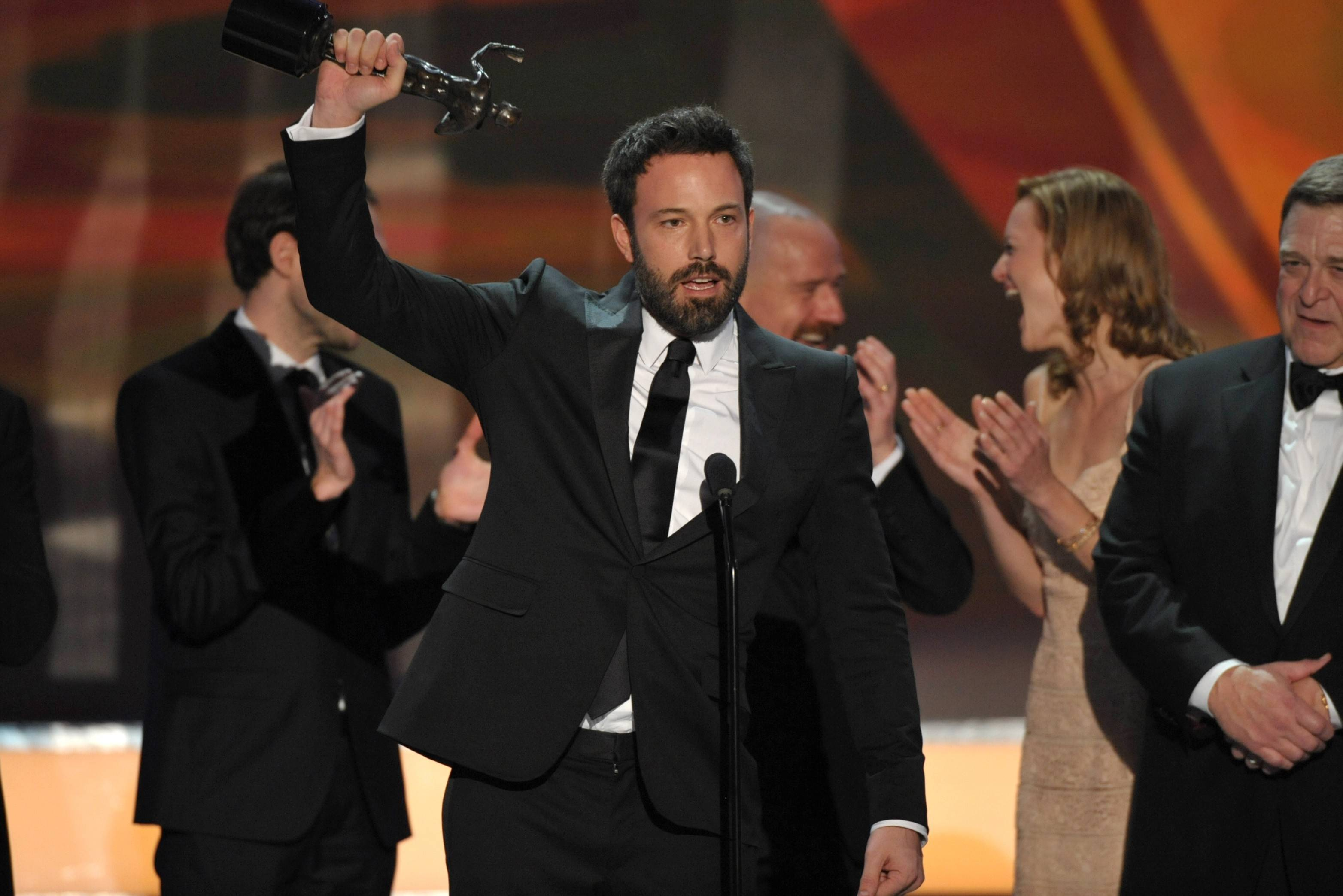 "Ben Affleck celebrates with the cast of ""Argo"" their win."