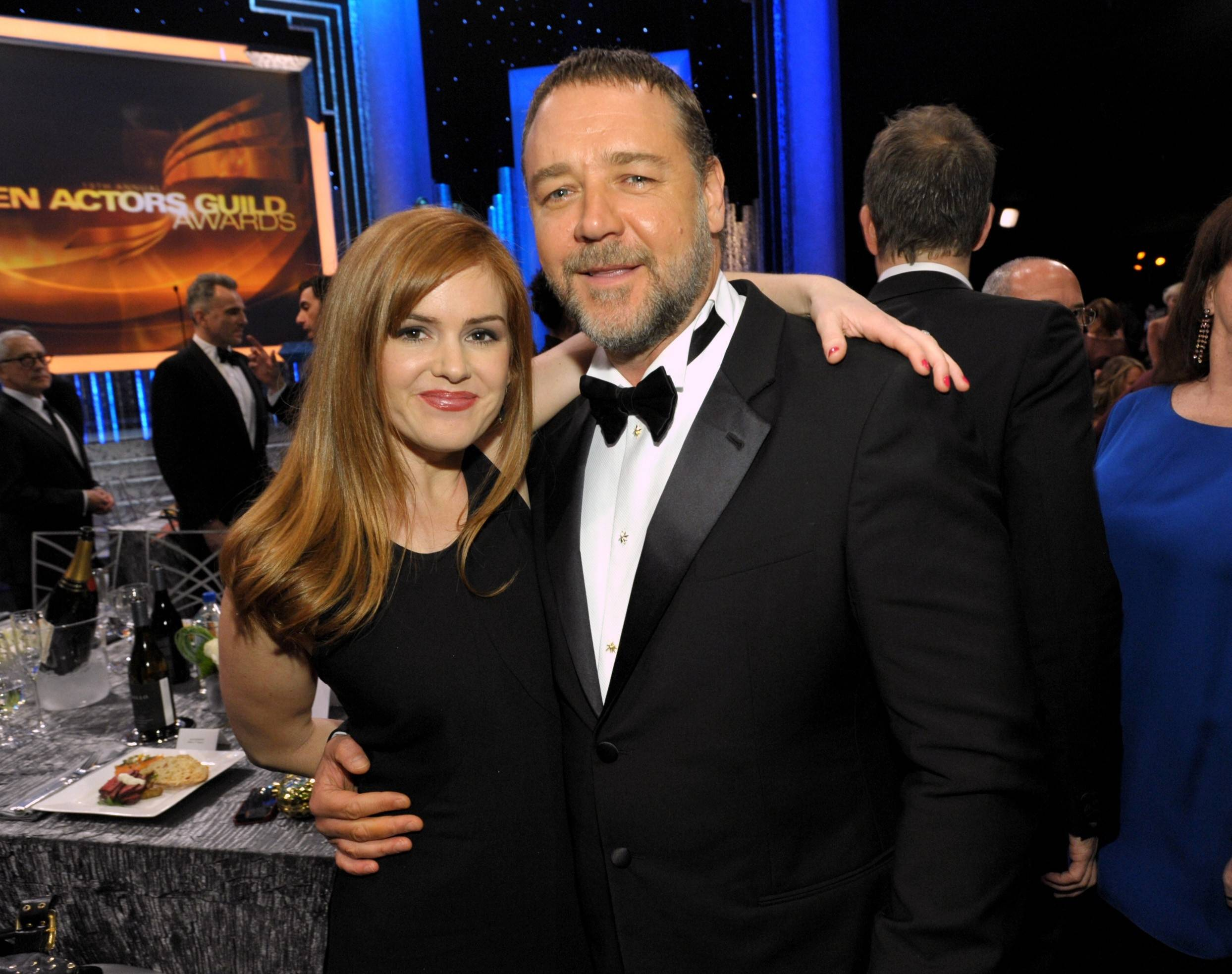 Isla Fisher and Russell Crowe smile for the camera during a commercial break at the SAG Awards.
