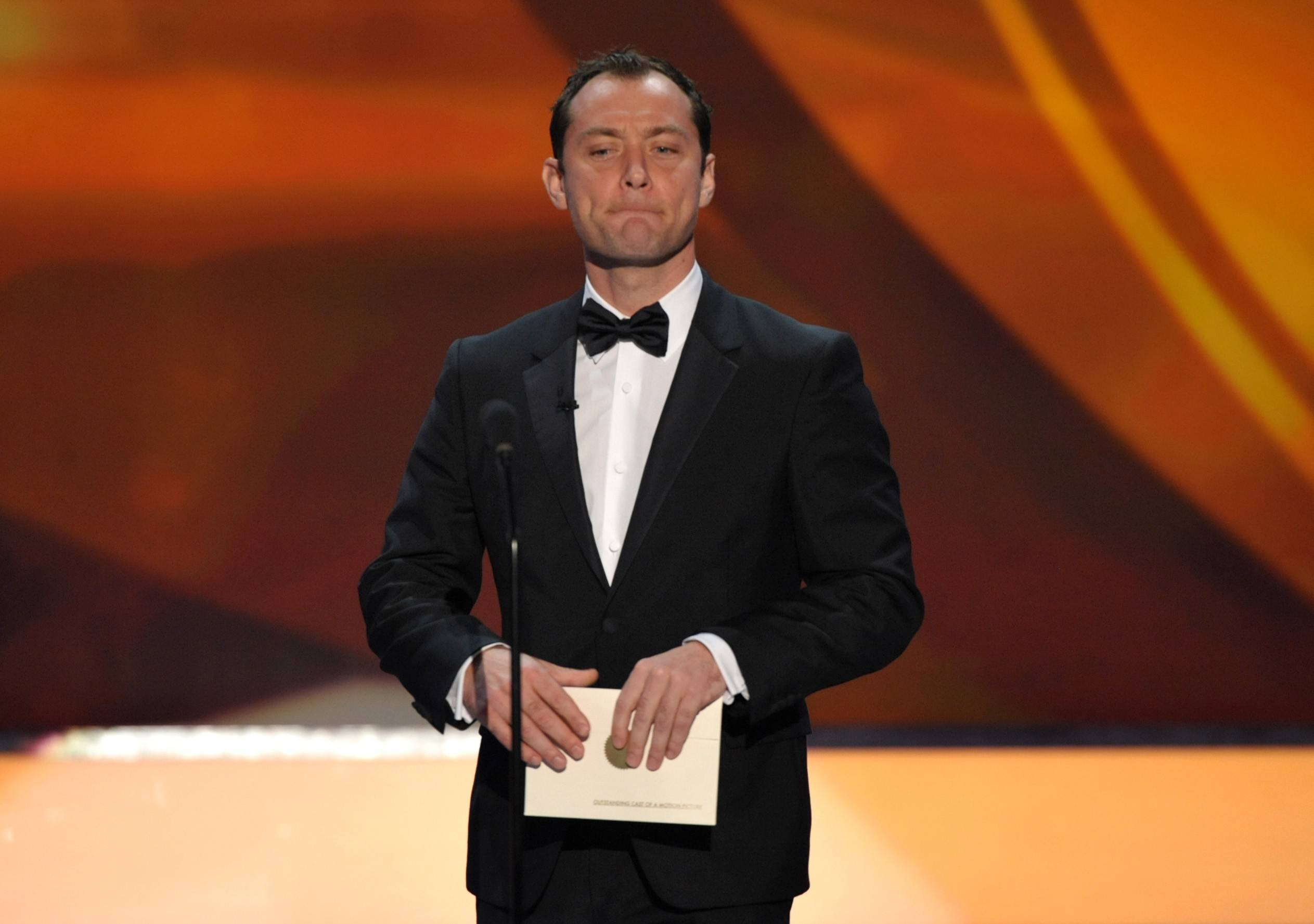 Jude Law presents the award for best cast.