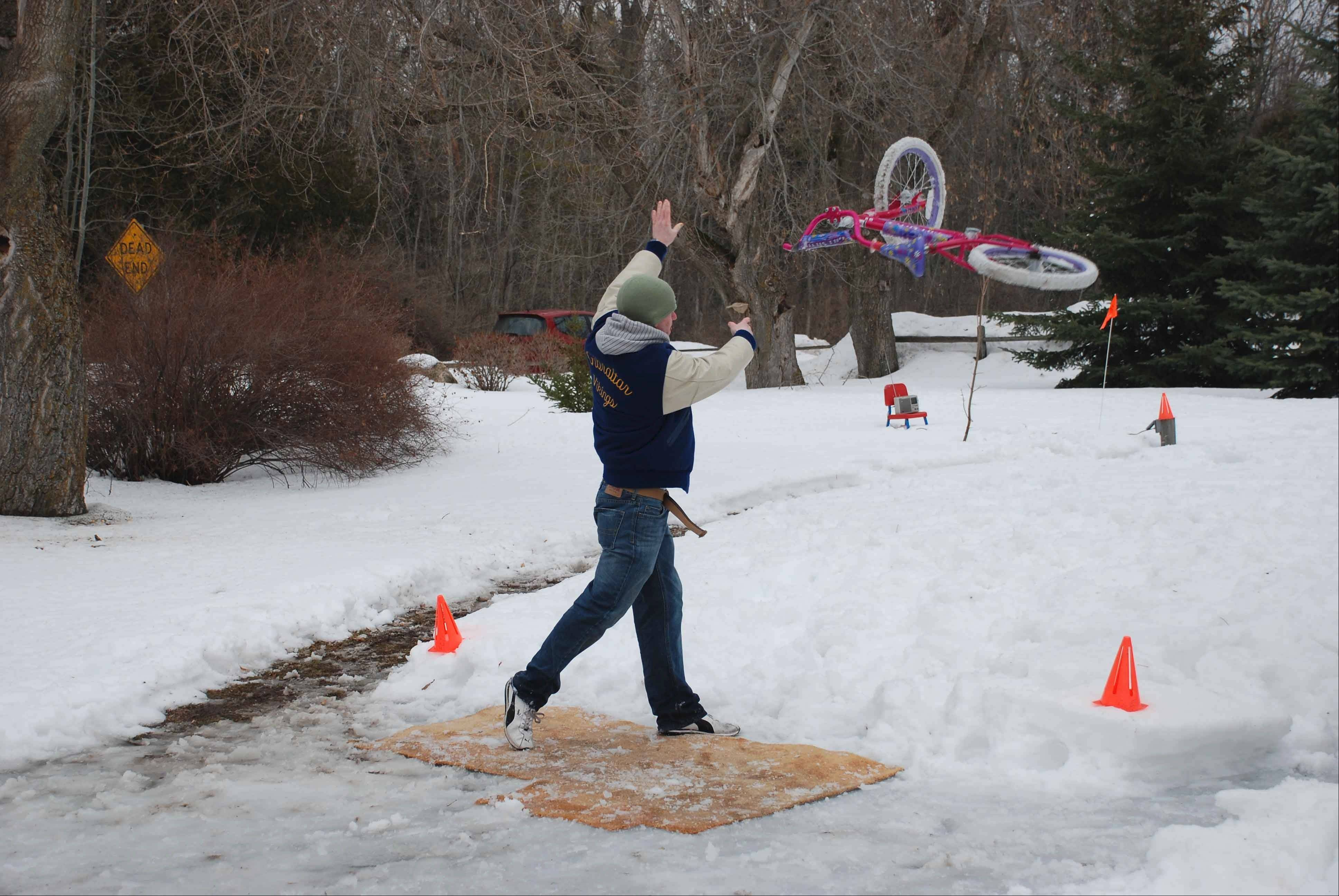 The popular bike toss is one of many fun and quirky games offered at Fish Creek's annual Winter Festival.